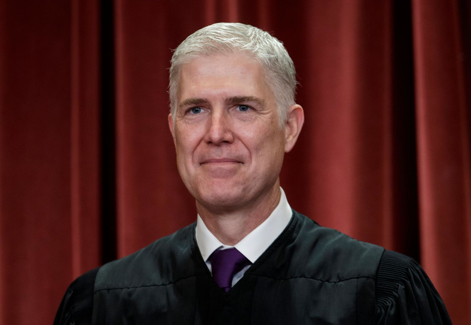FILE - In this Nov. 30, 2018 file photo, Associate Justice Neil Gorsuch sits with fellow Supreme Court justices for a group portrait at the Supreme Court Building in Washington. Gorsuch is the new honorary chairman of a nonpartisan group devoted to education about the Constitution, replacing former Vice President Joe Biden.(AP Photo/J. Scott Applewhite, File)