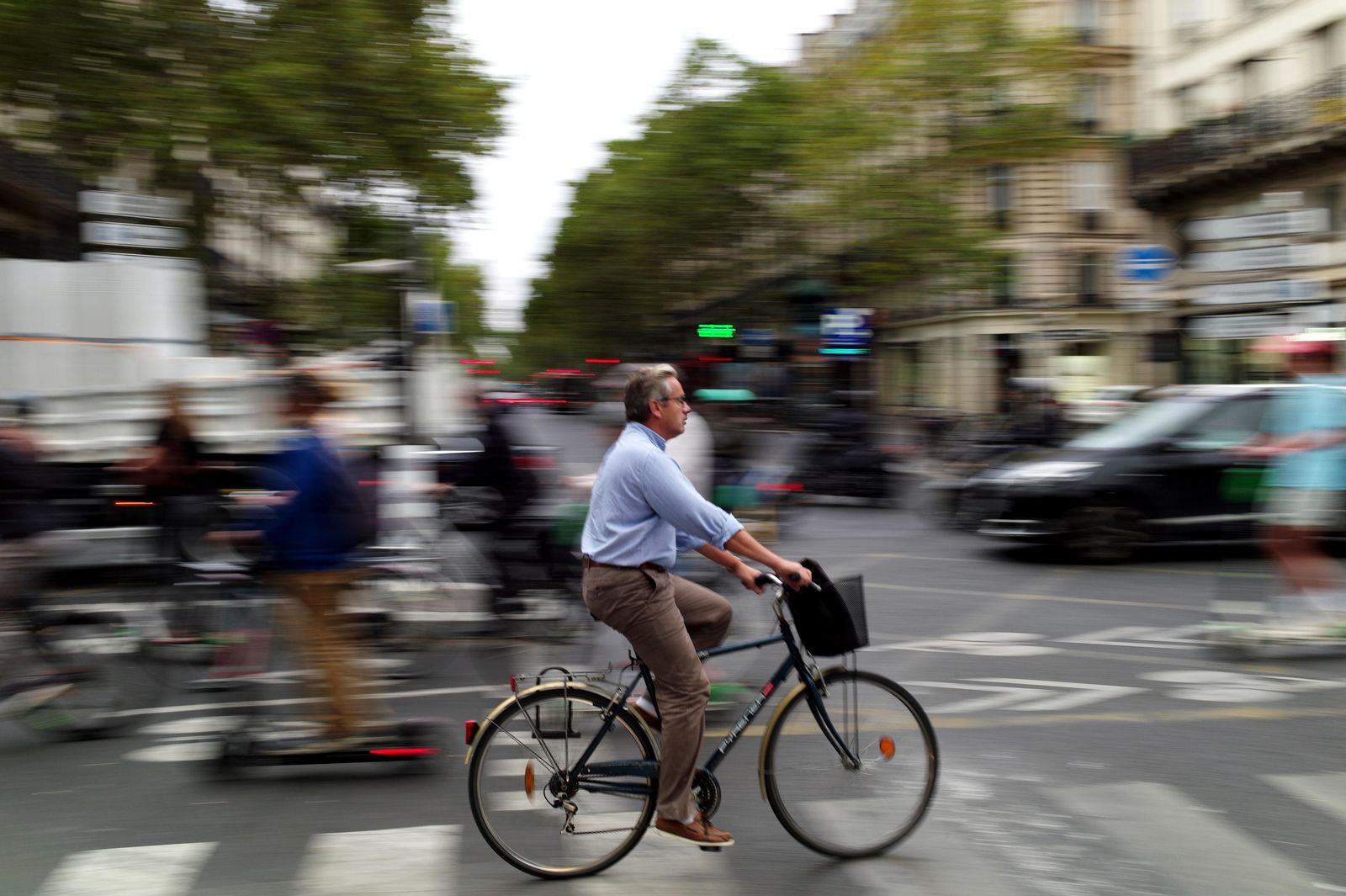 A man rides a bicycle in a street of Paris, Friday, Sept. 13, 2019. Paris metro warns over major strike, transport chaos Friday. (AP Photo/Thibault Camus)
