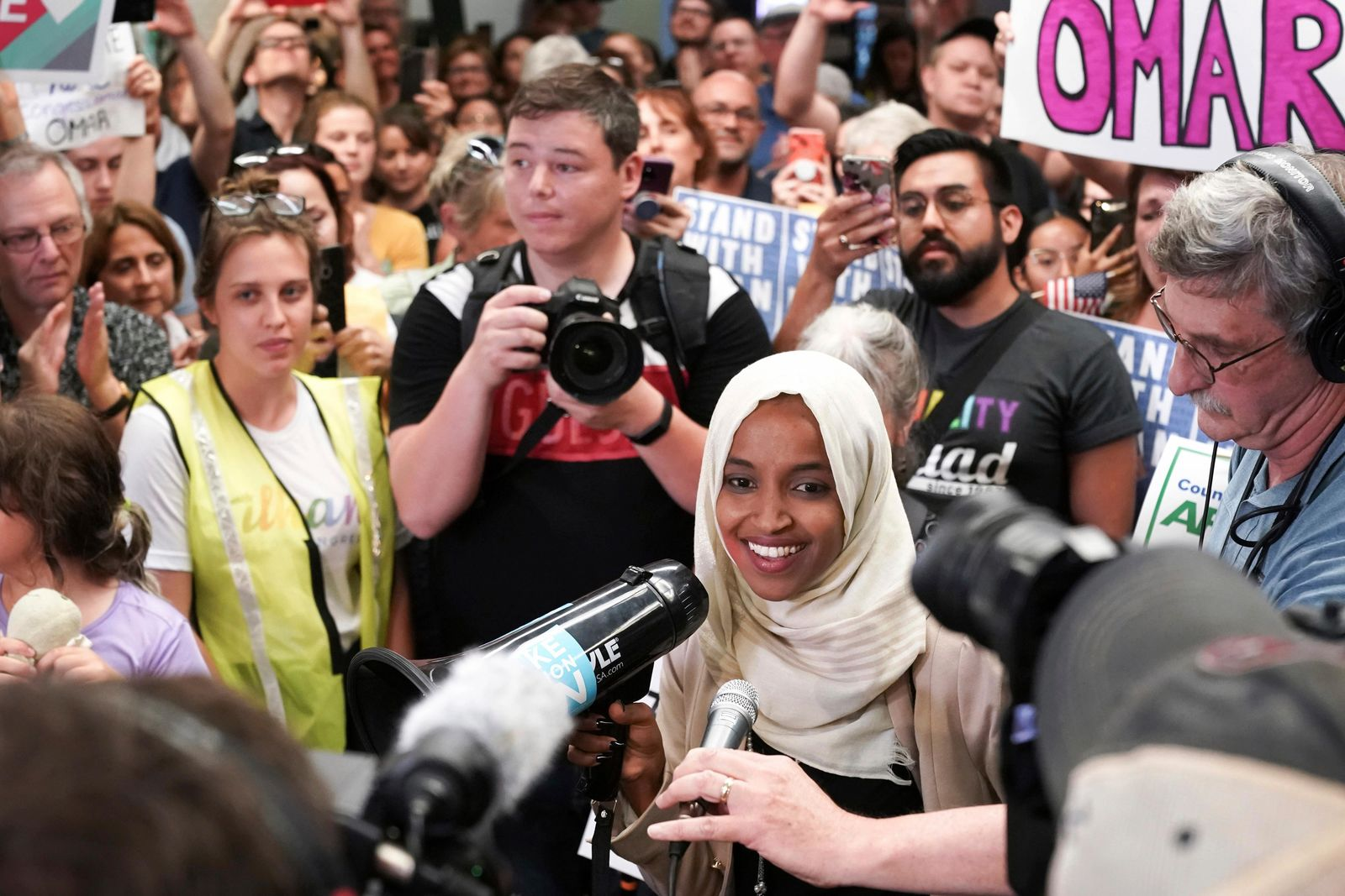 U.S. Rep. Ilhan Omar speaks to supporters as she arrives at Minneapolis–Saint Paul International Airport, Thursday, July 18, 2019, in Minnesota. (Glen Stubbe/Star Tribune via AP)