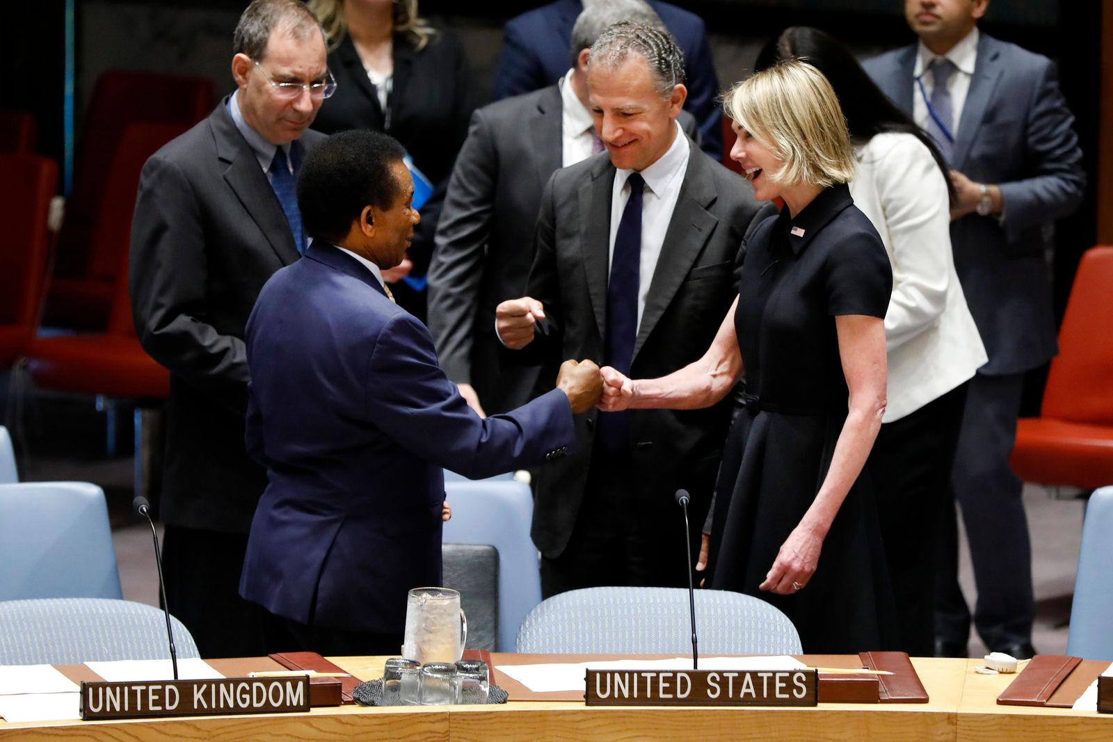 New U.S. Ambassador Kelly Craft receives a fist bump greeting from South Africa's Ambassador Jerry Matjila, left, as she attends her first Security Council meeting, at United Nations headquarters, Thursday, Sept. 12, 2019. (AP Photo/Richard Drew)