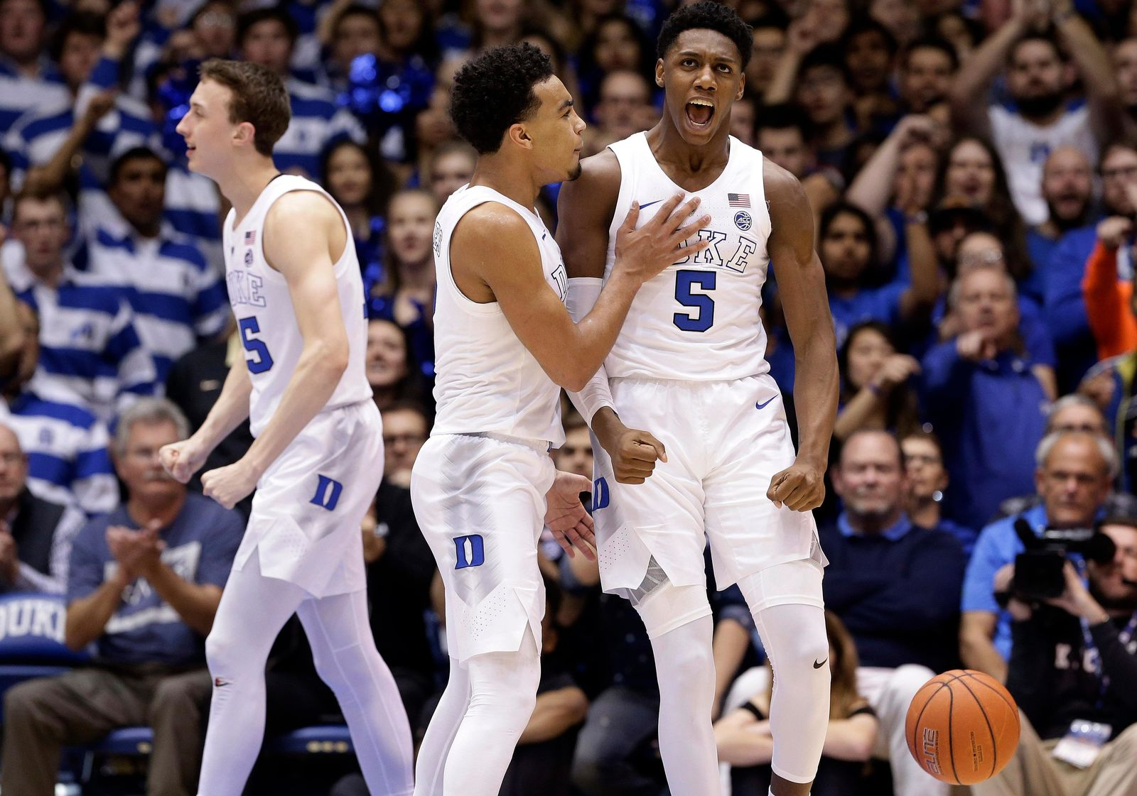 Duke's RJ Barrett (5) and Tre Jones react with Alex O'Connell, left, following a play against Wake Forest during the second half of an NCAA college basketball game in Durham, N.C., Tuesday, March 5, 2019. Duke won 71-70. (AP Photo/Gerry Broome)