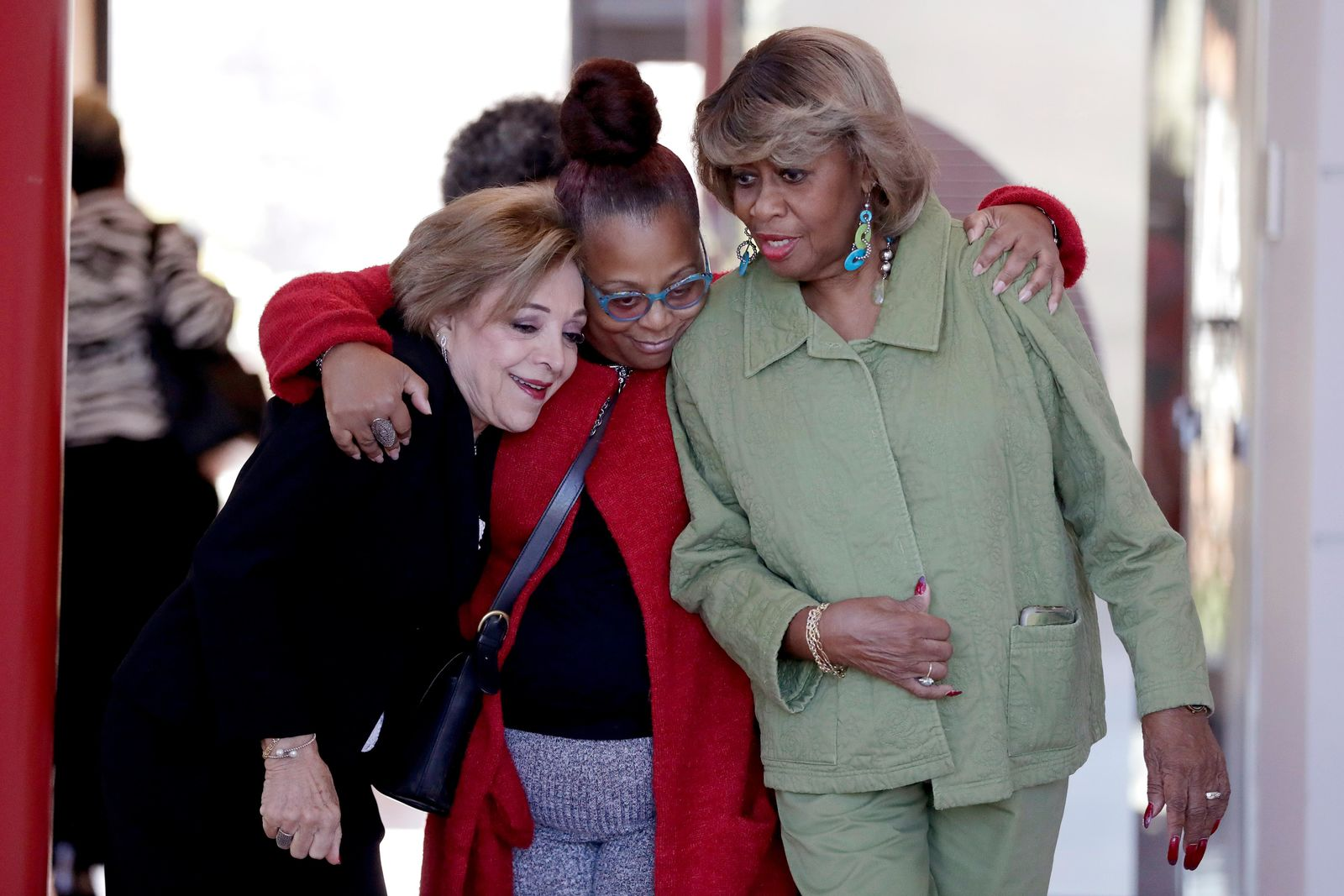 Women embrace as they walk out of Gilliam Concert Hall after viewing the open casket of U.S. Rep. Elijah Cummings during a viewing at Morgan State University, Wednesday, Oct. 23, 2019, in Baltimore.{ } (AP Photo/Julio Cortez)