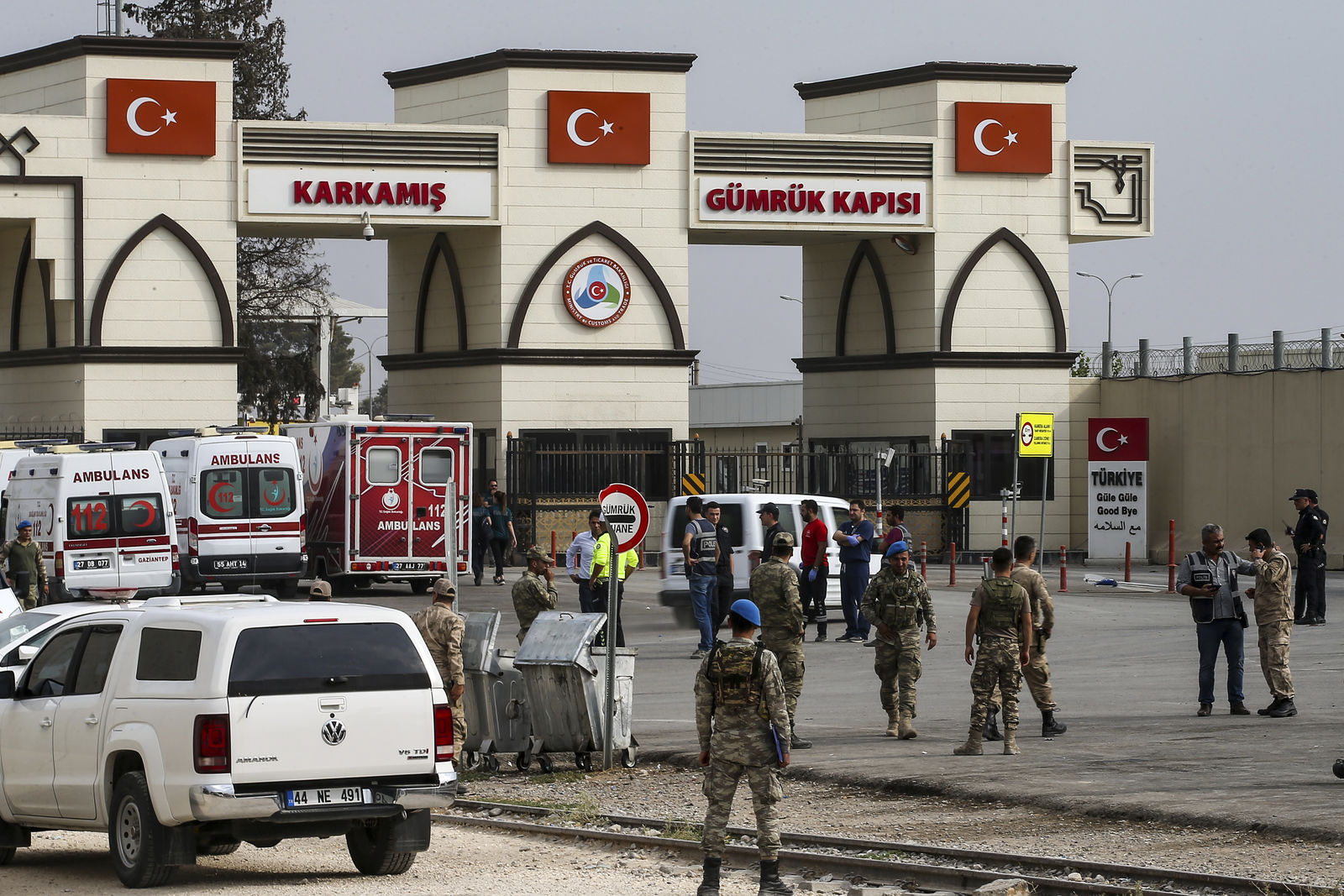 Turkish soldiers wait in the Karkamis border gate at Gaziantep province, southeastern Turkey, Wednesday, Oct. 16, 2019. Ambulances were going in an out of the Karkamis border crossing, just across the frontier from the Syrian town of Jarablus and some 30km north of Manbij, believed to be carrying injured in Turkey's military offensive in northern Syria. Turkish officials have not yet confirmed any clashes or casualties. (AP Photo/Emrah Gurel)