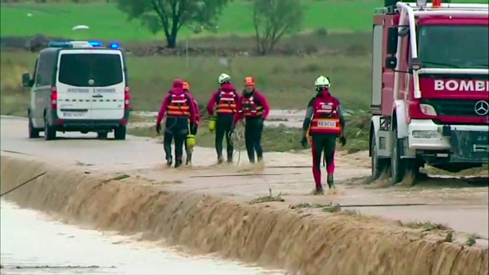In this image made from video provided by Atlas, firefightters attach ropes to an overturned vehicle in which two people were drowned by floodwater, in Caudete, Spain, Thursday, Sept. 12 2019.  A large area of southeast Spain was battered Thursday by what was forecast to be its heaviest rainfall in more than a century, with the storms wreaking widespread destruction and killing at least two people. (Atlas via AP)