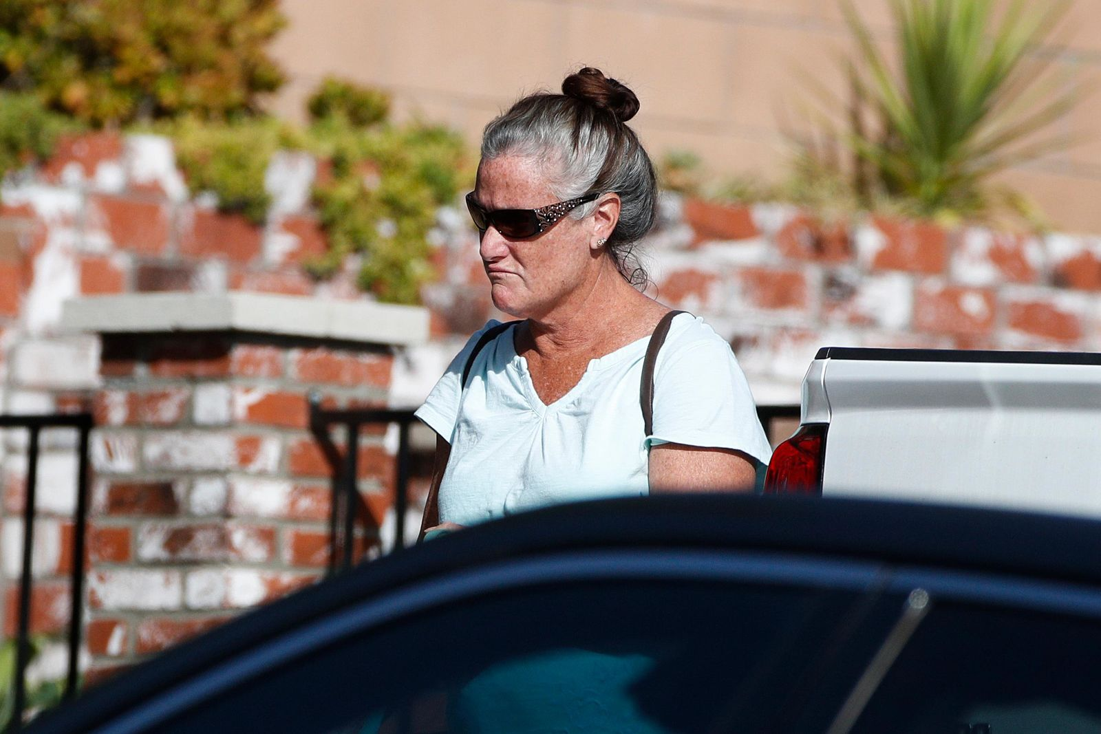 Colleen Long, mother of shooting suspect David Ian Long, leaves her house in Newbury Park, Calif., on Thursday, Nov. 8, 2018. (AP Photo/Jae C. Hong)