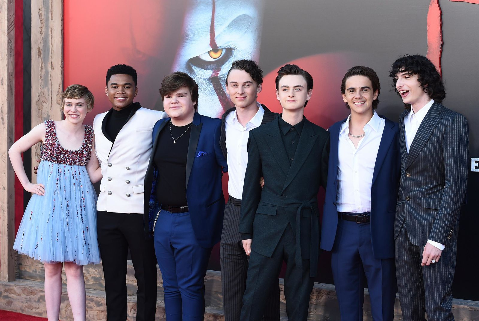 "FILE - In this Monday, Aug. 26, 2019 file photo, from left, cast members Sophia Lillis, Chosen Jacobs, Jeremy Ray Taylor, Wyatt Oleff, Jaeden Martell, Jack Dylan Grazer and Finn Wolfhard arrive at the Los Angeles premiere of ""It: Chapter 2,"" at the Regency Village Theatre. The movie opens Thursday, Sept. 5. (Photo by Jordan Strauss/Invision/AP, File)"