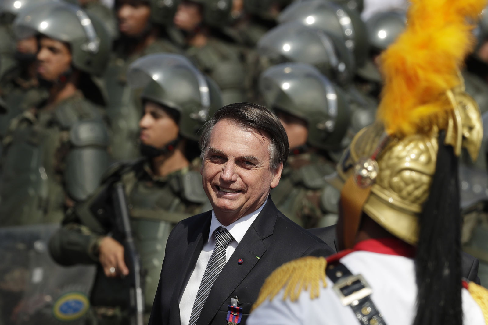 Brazils President Jair Bolsonaro arrive to attend a military ceremony for the Day of the Soldier, at Army Headquarters in Brasilia, Brazil, Friday, Aug. 23, 2019.{ } (AP Photo/Eraldo Peres)
