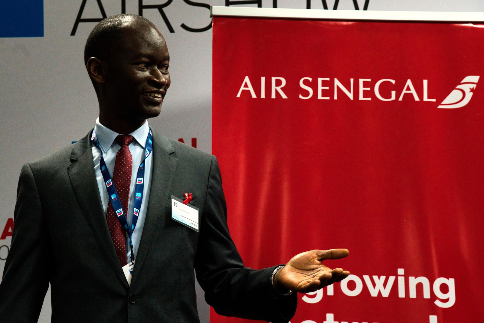 Air Senegal CEO Ibrahima Kane gestures before the start of a news conference at the Dubai Airshow in Dubai, United Arab Emirates, Tuesday, Nov. 19, 2019. (AP Photo/Jon Gambrell)