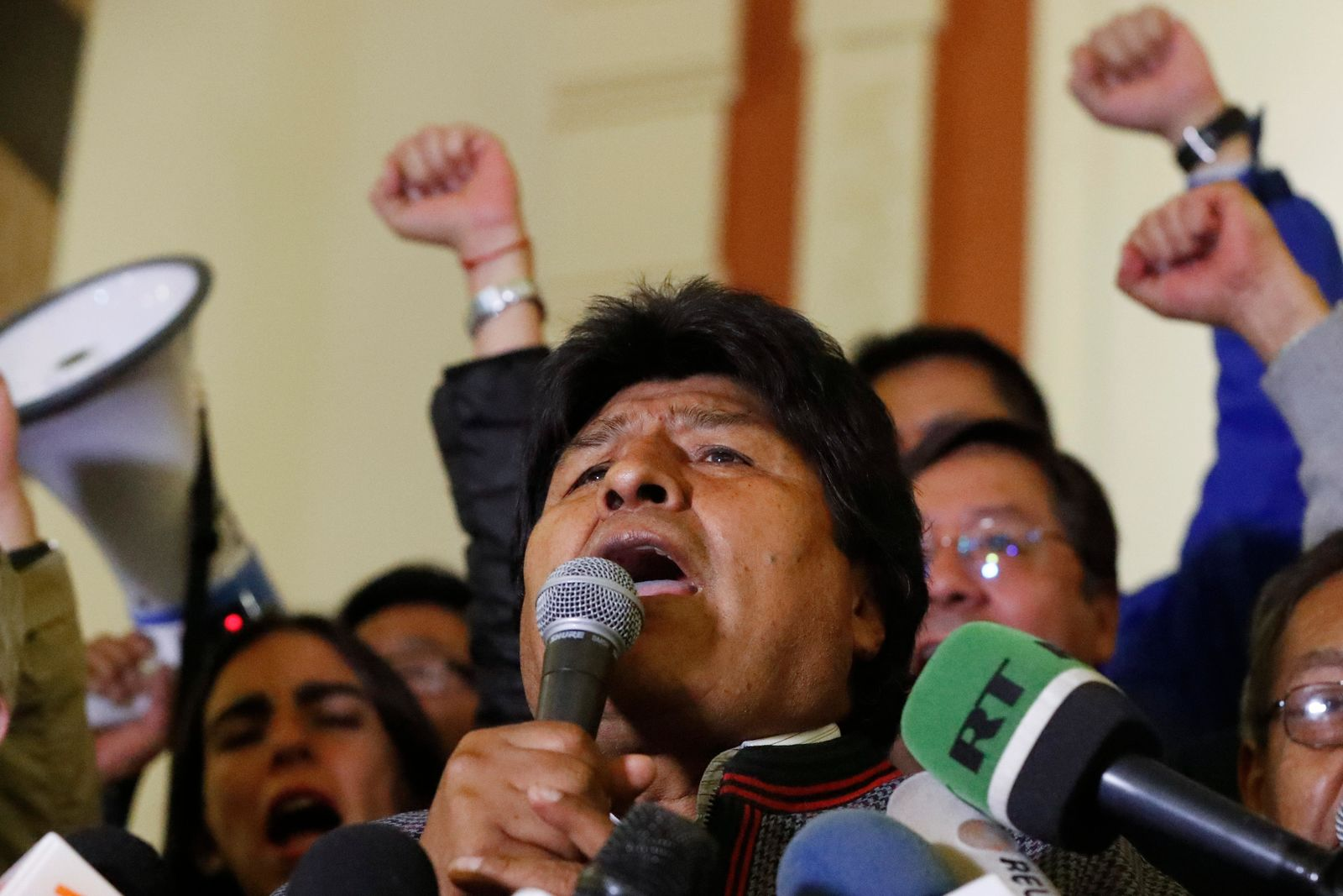 Bolivian President Evo Morales speaks to supporters at the presidential palace in La Paz, Bolivia, after a first round presidential election, Sunday, Oct. 20, 2019. . (AP Photo/Jorge Saenz)