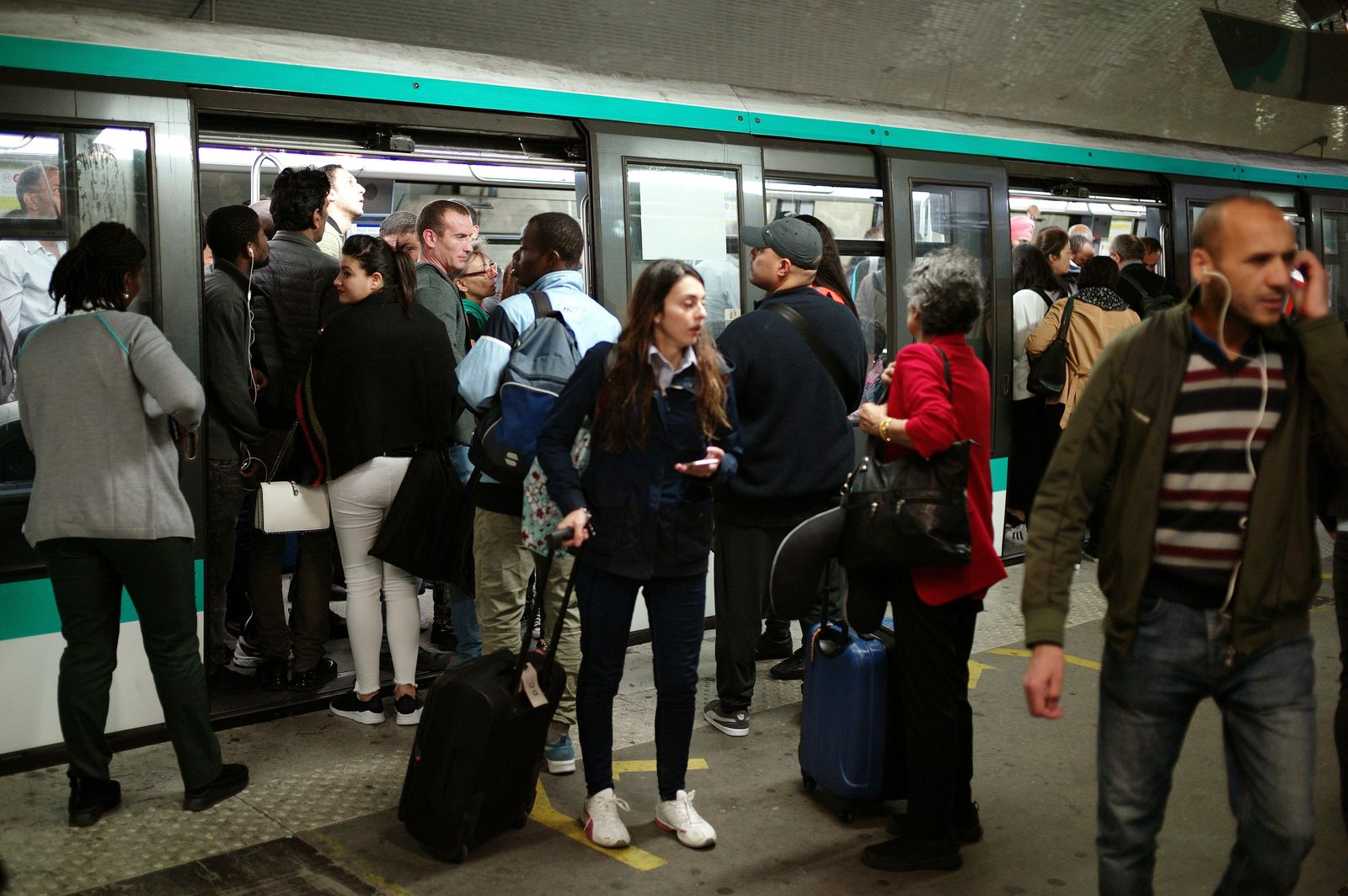 Commuters board a train, in Gare du Nord railway station, in Paris, Friday, Sept. 13, 2019. Paris metro warns over major strike, transport chaos Friday. (AP Photo/Thibault Camus)