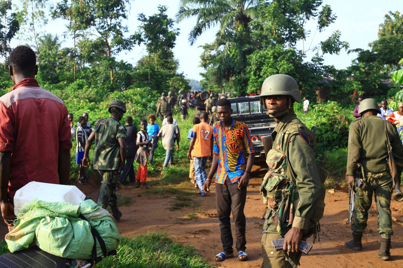 In this photo taken Friday, Oct 5, 2018, Congolese Soldiers patrol in an area civilians were killed by The Allied Democratic Forces rebels in Beni, Eastern Congo. (AP Photo/Al-hadji Kudra Maliro)