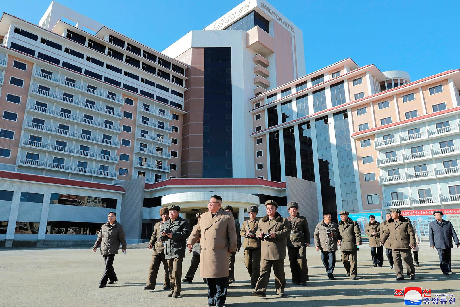 "In this undated photo provided on Wednesday, Oct. 16, 2019, by the North Korean government, North Korean leader Kim Jong Un, foreground, visits a construction site in Samjiyon County, North Korea. Independent journalists were not given access to cover the event depicted in this image distributed by the North Korean government. The content of this image is as provided and cannot be independently verified. Korean language watermark on image as provided by source reads: ""KCNA"" which is the abbreviation for Korean Central News Agency. (Korean Central News Agency/Korea News Service via AP)"
