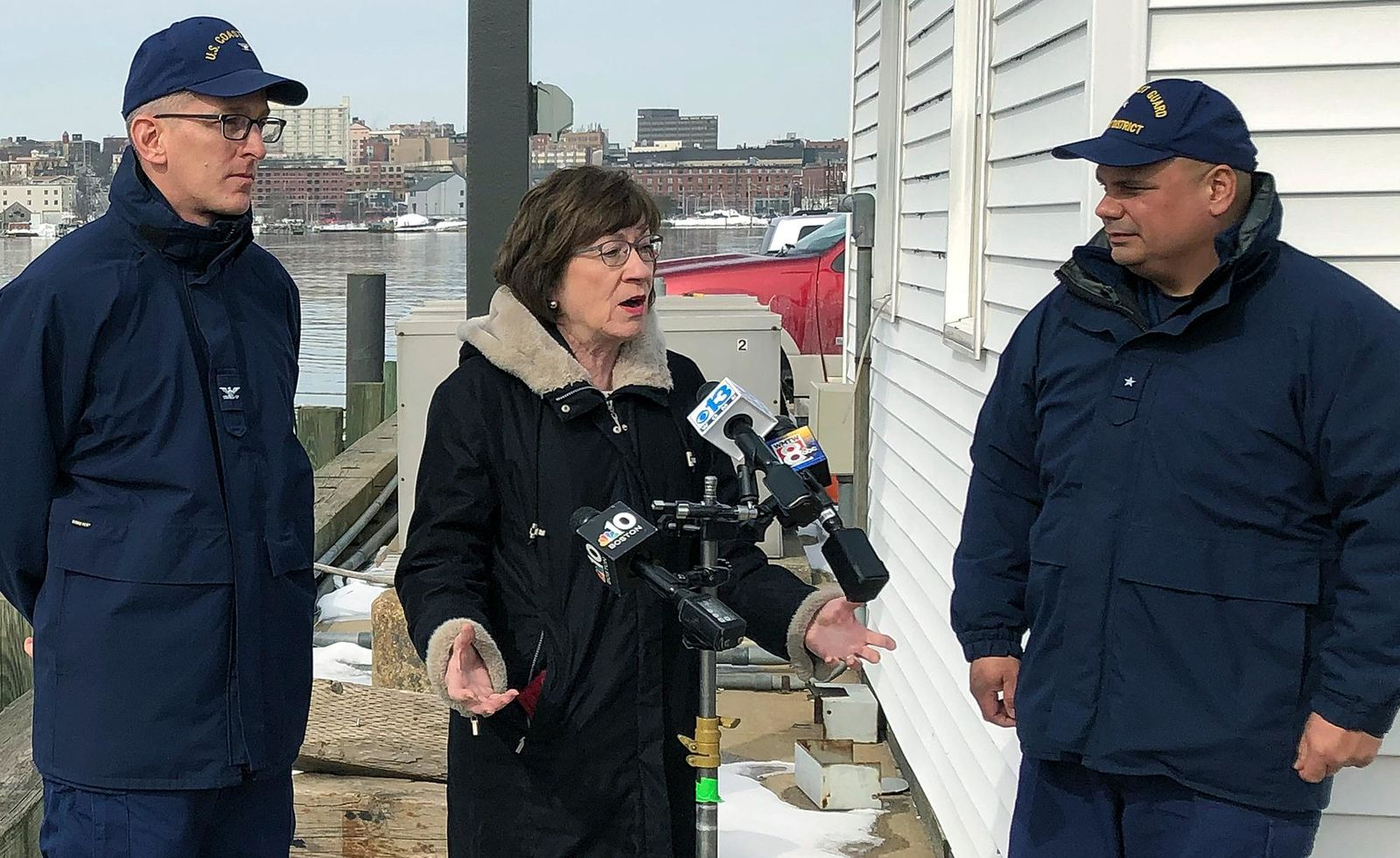 FILE - In this Feb. 20, 2019, file photo, Sen. Susan Collins, R-Maine, is flanked by Coast Guard Capt. Brian LeFebvre, left, and Rear Adm. Andrew Tiongson, right, as she addresses reporters after the ribbon-cutting at a U.S. Coast Guard regional command center in South Portland, Maine. (AP Photo/David Sharp, File)