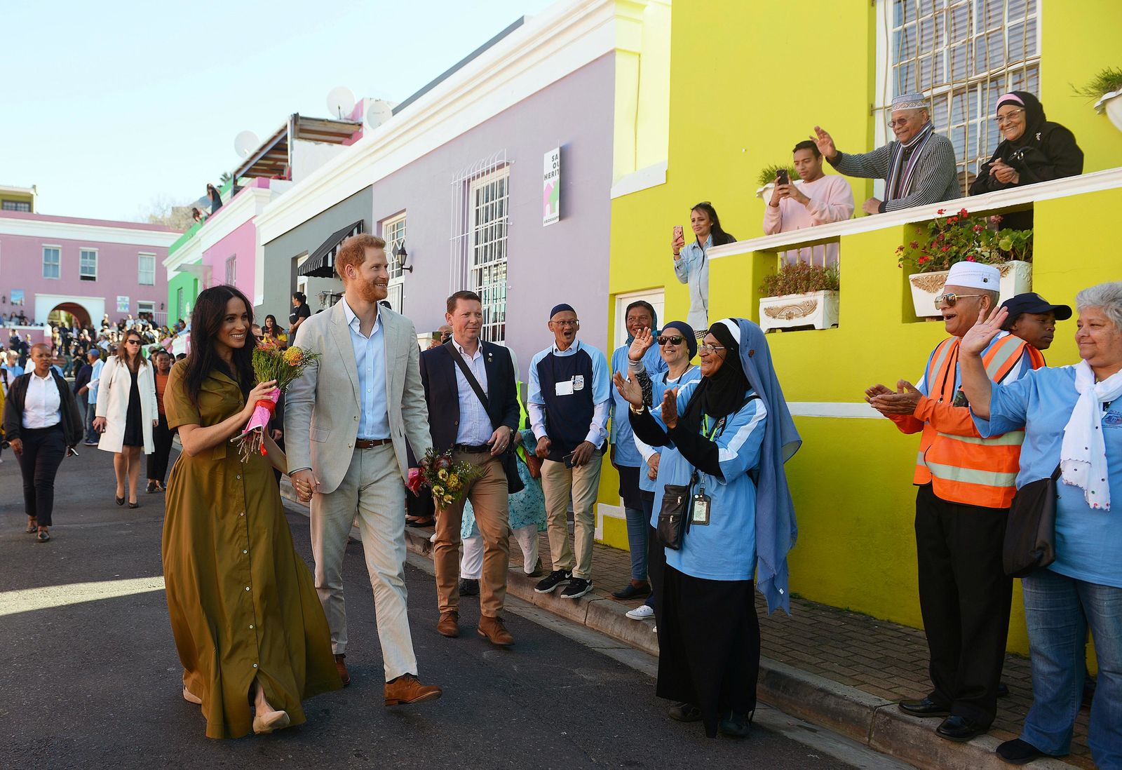 FILE - In this Tuesday, Sept, 24, 2019 file photo, Britain's Prince Harry, and his wife, Meghan, the Duchess of Sussex, during a walkabout in Bo-Kaap, a heritage site, in Cape Town, South Africa.  (Courtney Africa/Pool via AP, File)
