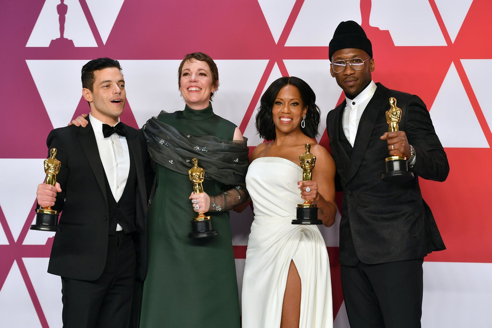 "FILE - This Feb. 24, 2019 file photo shows Oscar winners, from left, Rami Malek, for best performance by an actor in a leading role for ""Bohemian Rhapsody"", Olivia Colman, for best performance by an actress in a leading role for ""The Favourite"", Regina King, for best performance by an actress in a supporting role for ""If Beale Street Could Talk"", and Mahershala Ali, for best performance by an actor in a supporting role for ""Green Book"", holding their awards in the press room at the Oscars in Los Angeles. (Photo by Jordan Strauss/Invision/AP, File)"