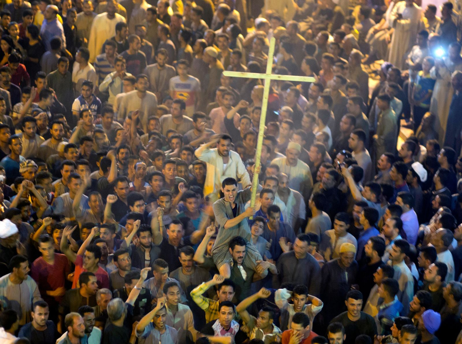 Coptic Christians shout slogans after the funeral service of some of the victims of a bus attack, at Abu Garnous Cathedral in Minya, Egypt, Friday, May 26, 2017. (AP Photo/Amr Nabil)