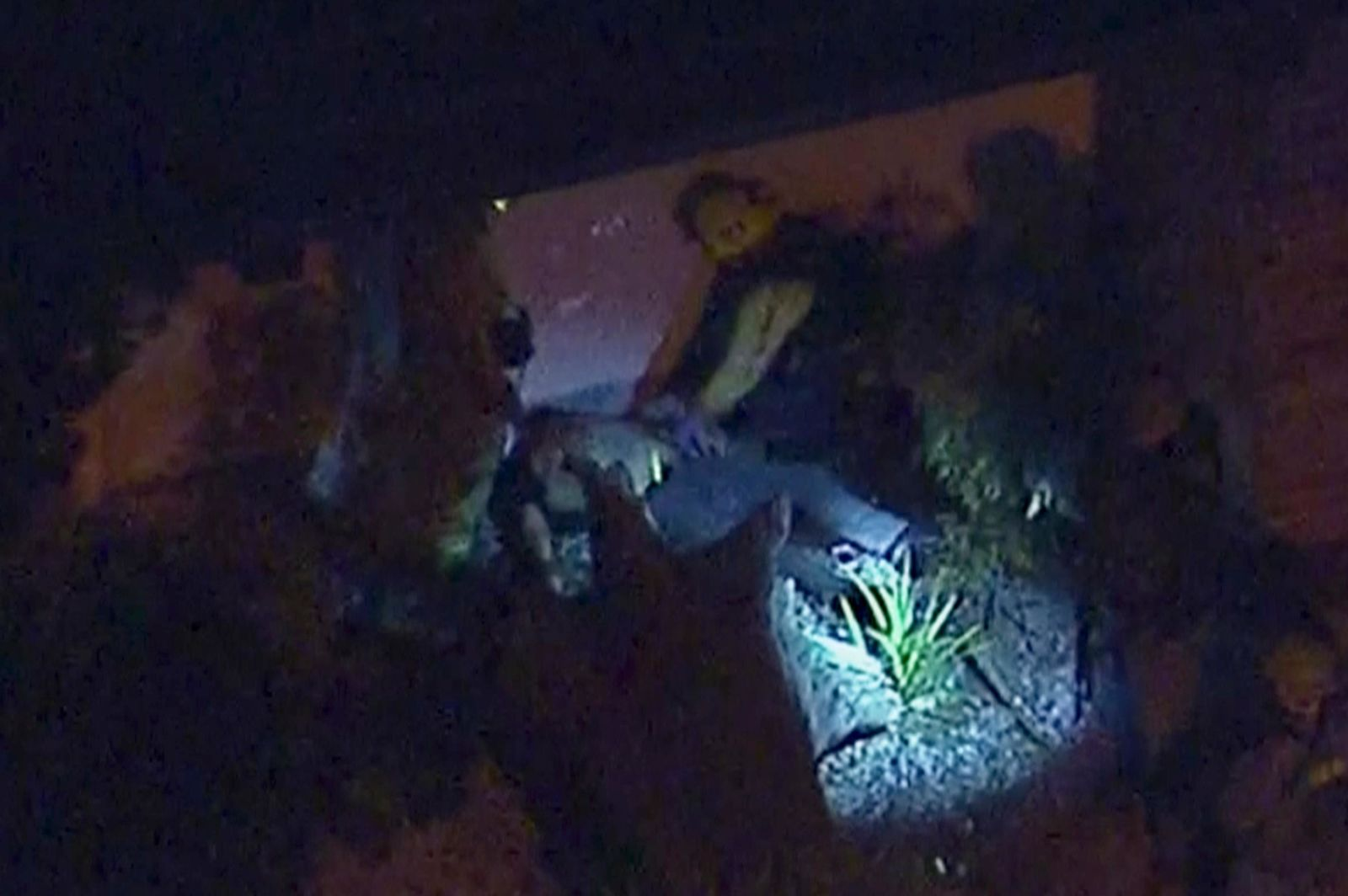 In this image made from aerial video, officials tend to a person on the ground in the vicinity of a shooting in Thousand Oaks, California, early Thursday, Nov. 8, 2018. (KABC via AP)