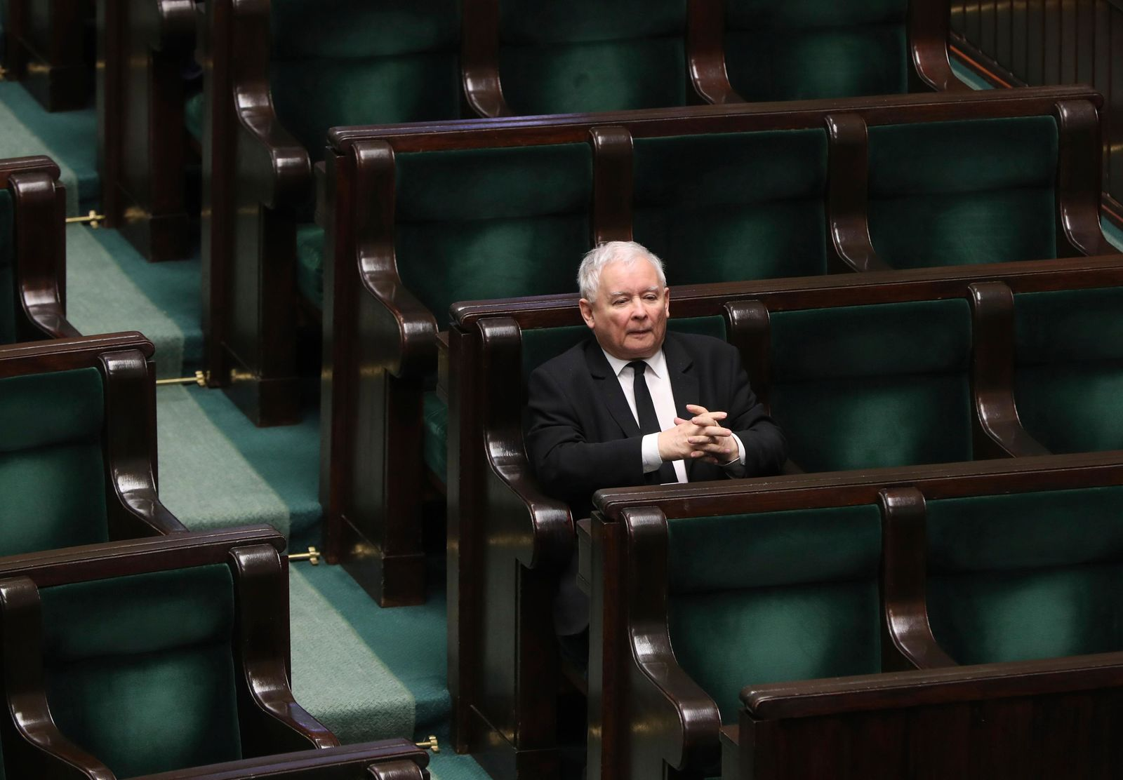 Jaroslaw Kaczynski, leader of the conservative ruling party Law and Justice, takes part in a parliamentary session in Warsaw, Poland, Friday, April 3, 2020.{ } (AP Photo/Czarek Sokolowski)