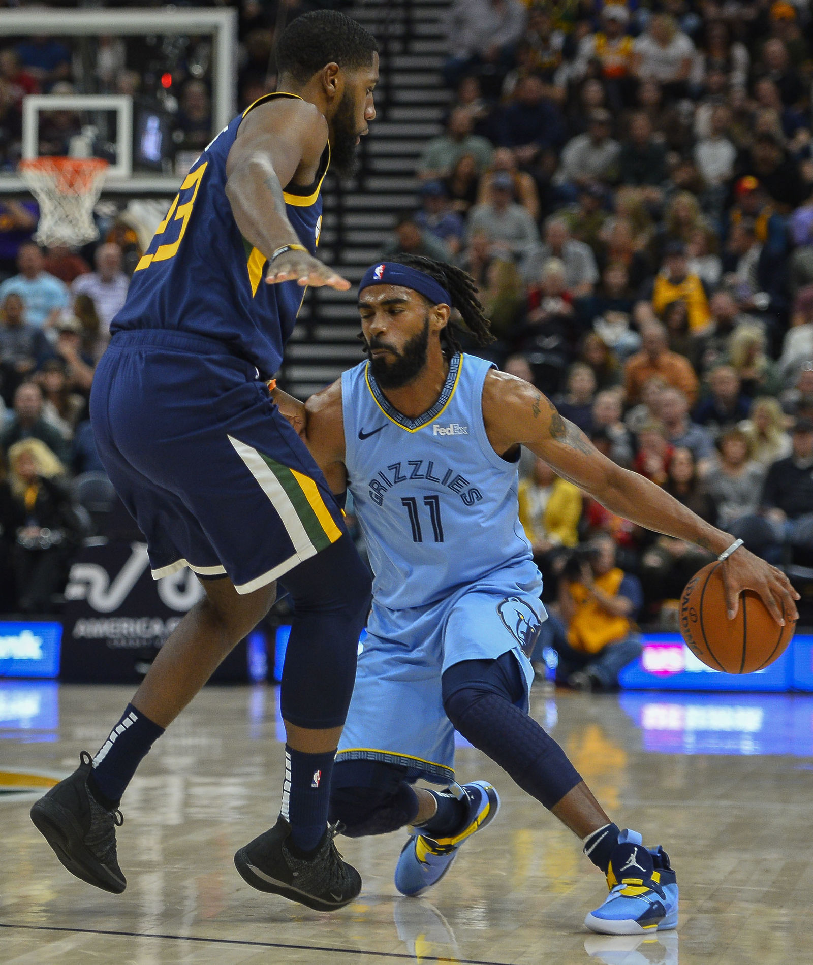 Memphis Grizzlies guard Mike Conley (11) attempts to drive around Utah Jazz forward Royce O'Neale (23) during the first half of an NBA basketball game Friday, Nov. 2, 2018, in Salt Lake City. (AP Photo/Alex Goodlett)