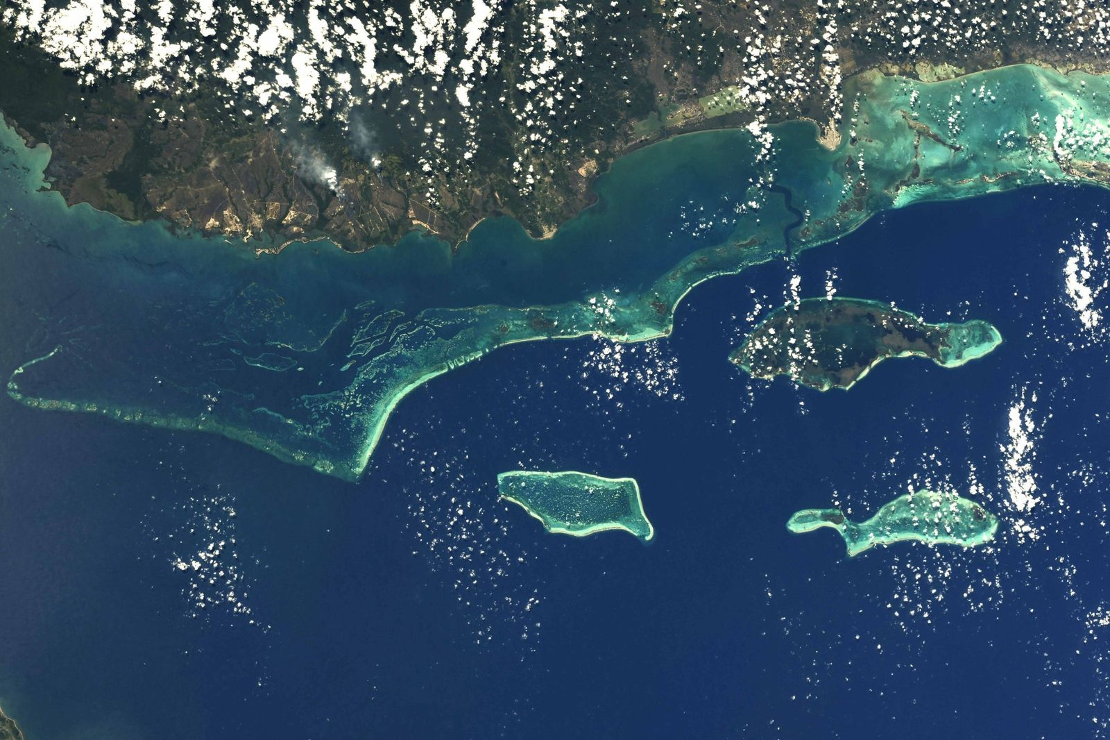 Charles Darwin called it ?the most remarkable reef in the West Indies?. I am inclined to agree. #Belize Barrier Reef (Photo & Caption Ricky Arnold, NASA)