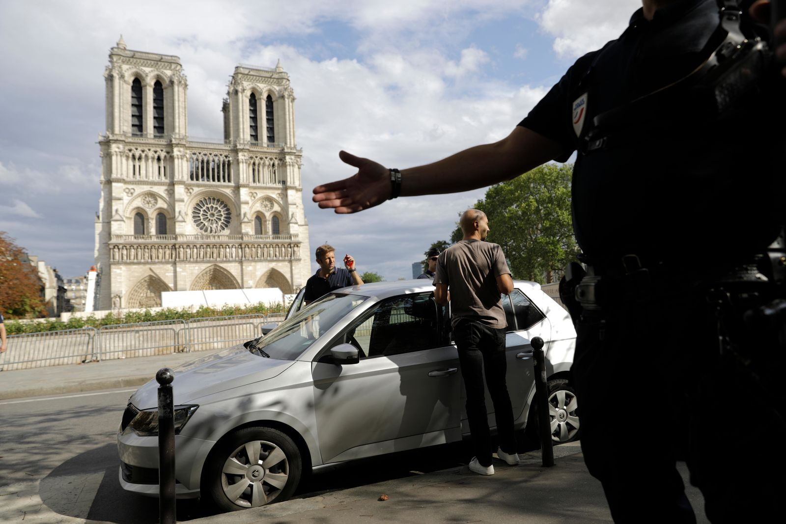 Police officers clear the area around Notre Dame cathedral in Paris, Monday, Aug. 12, 2019.r. (AP Photo/Lewis Joly)