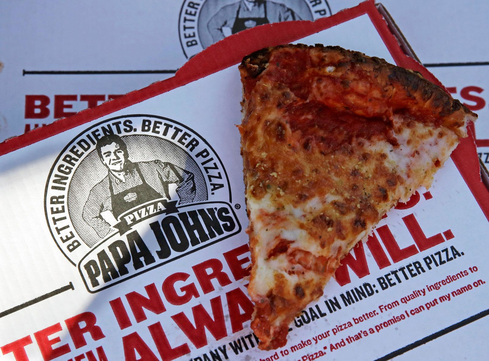 FILE- This Dec. 21, 2017, file photo shows a slice of cheese pizza at the Papa John's pizza shop in Quincy, Mass.{ } (AP Photo/Charles Krupa, File)