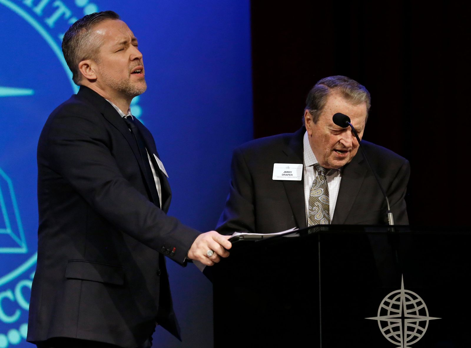 Southern Baptist Convention President J.D. Greear, left, prays with Jimmy Draper, right, a former denomination president, before Greear spoke to the denomination's executive committee Monday, Feb. 18, 2019, in Nashville, Tenn. (AP Photo/Mark Humphrey)
