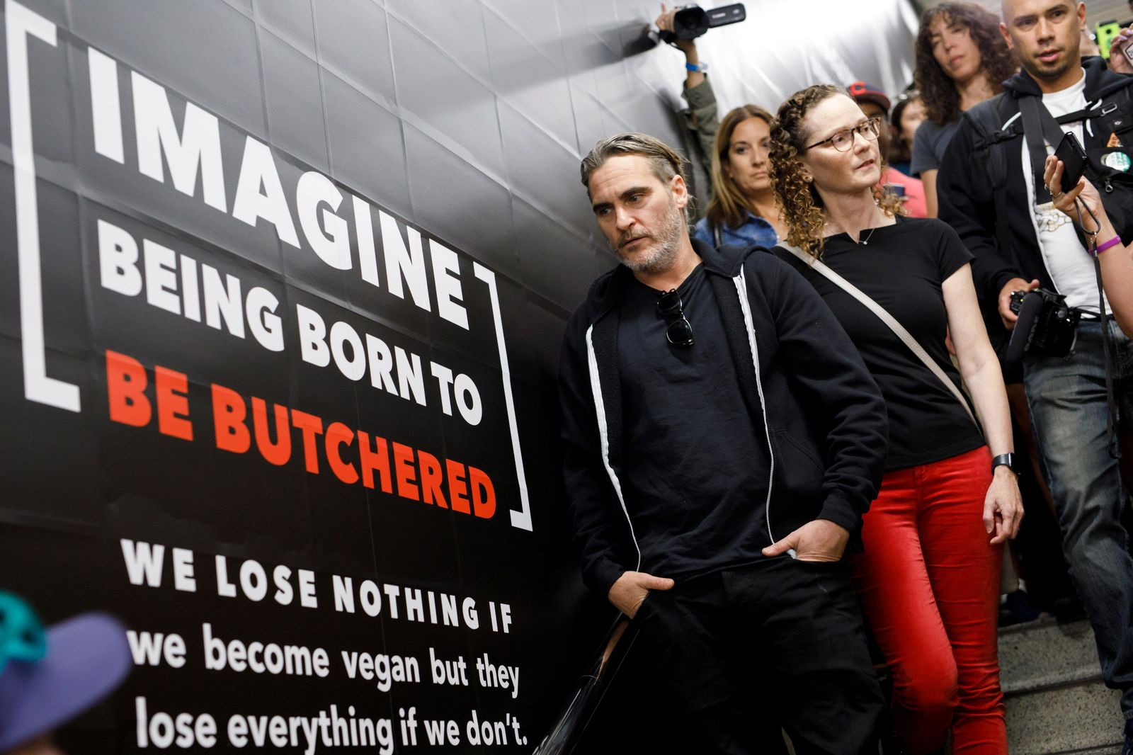 Actor Joaquin Phoenix appears next to a vegan ad campaign inside a subway station in Toronto, Monday, Sept. 9, 2019. (Cole Burston/The Canadian Press via AP)