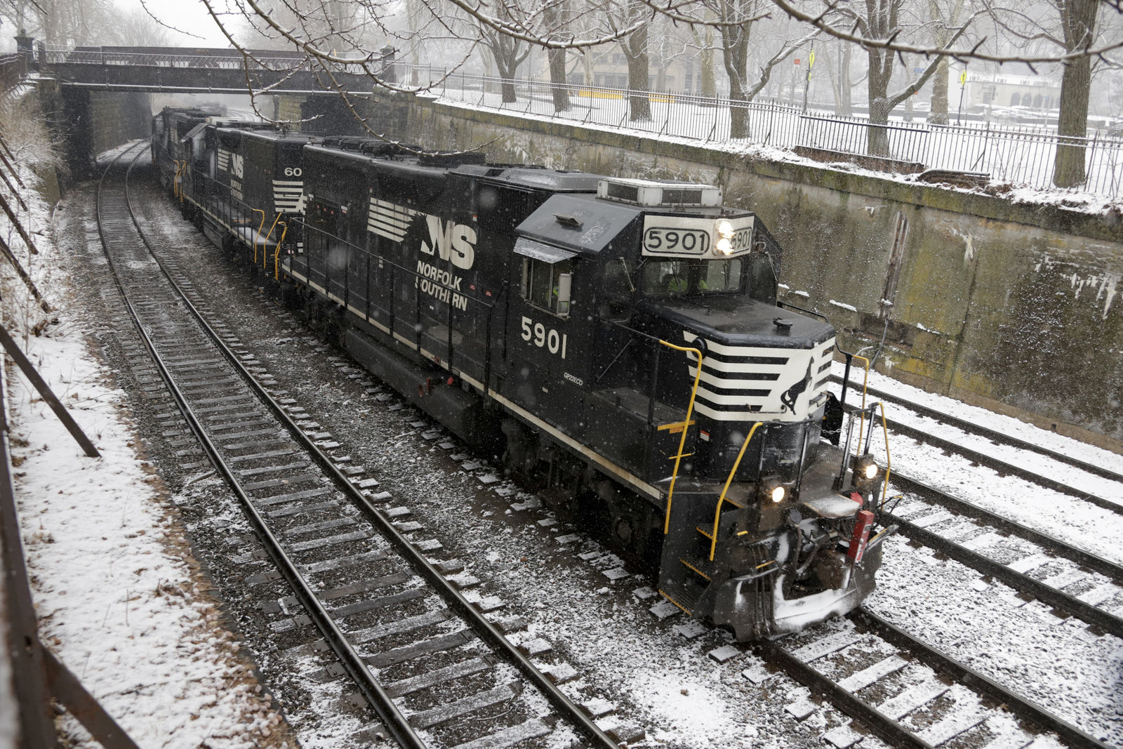 FILE - In this March 3, 2019, file photo a Norfolk Southern Railway Company freight train passes through Pittsburgh. More than two dozen major companies ranging from Campbell Soup to Kia filed anti-trust lawsuits on Sept. 30, 2019 against the nation's four largest railway companies, contending the railroads had a price-fixing scheme to illegally boost profits.(AP Photo/Gene J. Puskar, File)