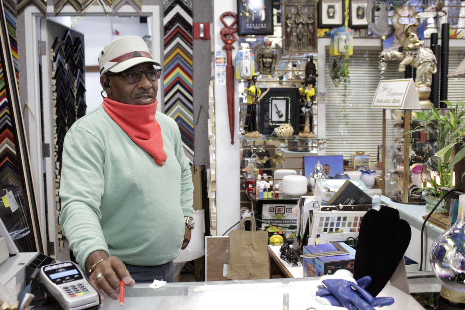 Jerome Polk stands behind the counter of his business, J.P's Custom Framing, on Wednesday, July 1, 2020, as he discusses protests that have been unfolding nightly in a historically Black neighborhood in Portland, Ore. (AP Photo/Gillian Flaccus)