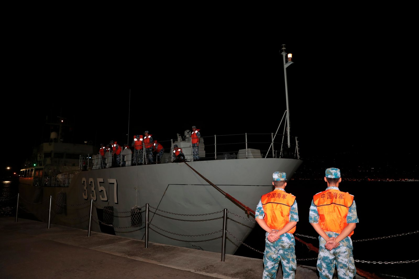 In this photo released by China's Xinhua News Agency, a ship from China's People's Liberation Army (PLA) Navy arrives at a naval base on Stonecutters Island in Hong Kong, Thursday, Aug. 29, 2019.. (Yuan Junmin/Xinhua via AP)