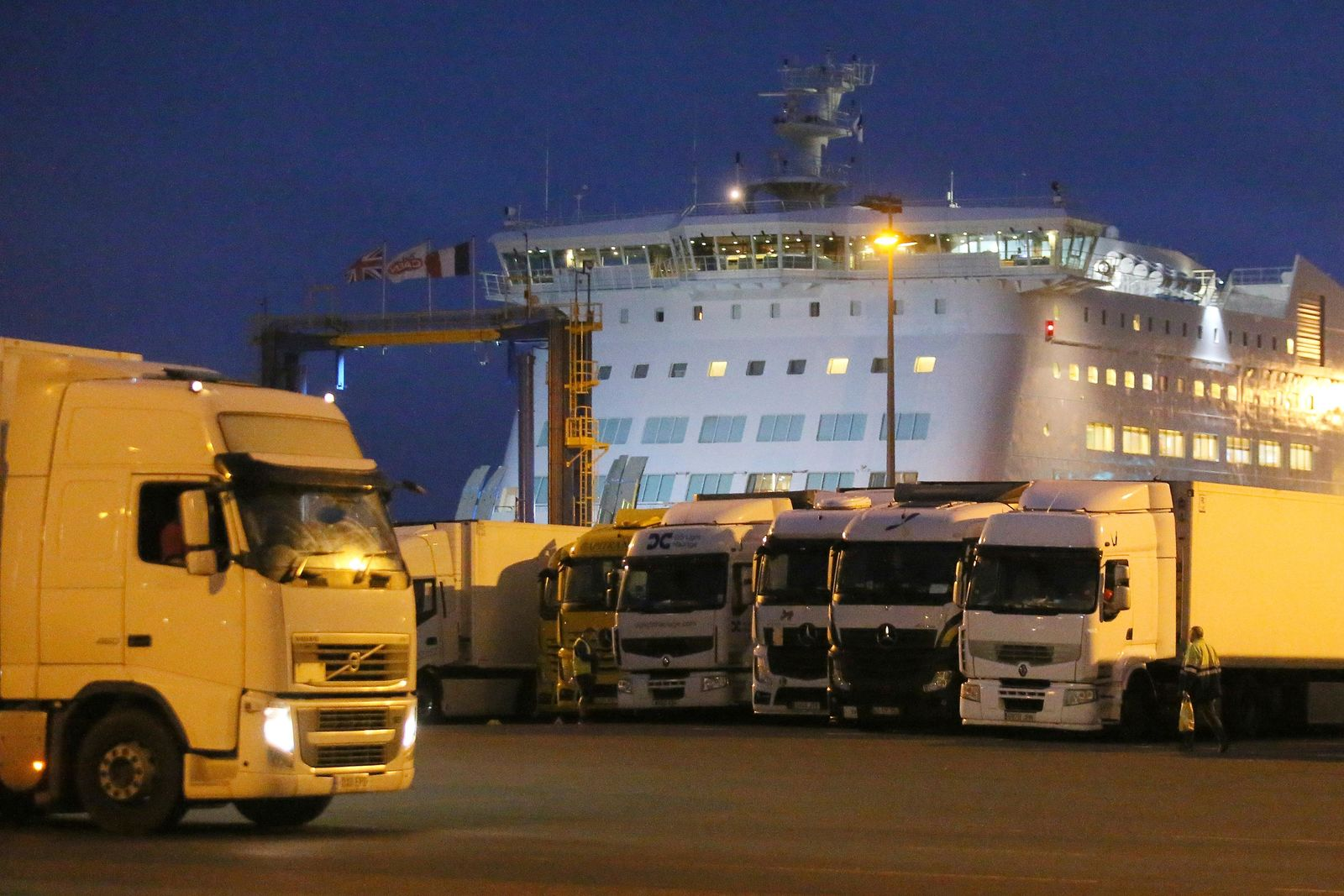 Trucks park as a ferry coming from Britain's port of Portsmouth docks at the transit zone at the port of Ouistreham, Normandy, Thursday, Sept.12, 2019. France has trained 600 new customs officers and built extra parking lots arounds its ports to hold vehicles that will have to go through extra checks if there is no agreement ahead of Britain's exit from the EU, currently scheduled on Oct. 31. (AP Photo/David Vincent)