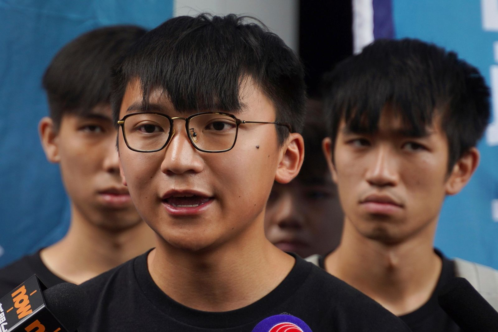 Issac Cheng, vice-chairperson of Demosisto, center, speaks to reporters in Hong Kong Friday, Aug. 30, 2019.{ } (AP Photo/Vincent Yu)