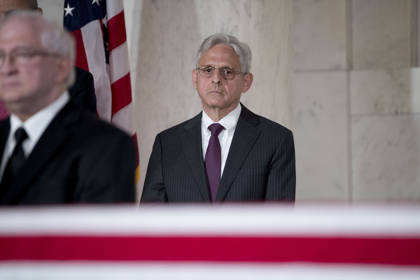 Former President Barack Obama's Supreme Court nominee Merrick Garland pays his respects for the late Supreme Court Justice John Paul Stevens as he lies in repose in the Great Hall of the Supreme Court in Washington, Monday, July 22, 2019. (AP Photo/Andrew Harnik)