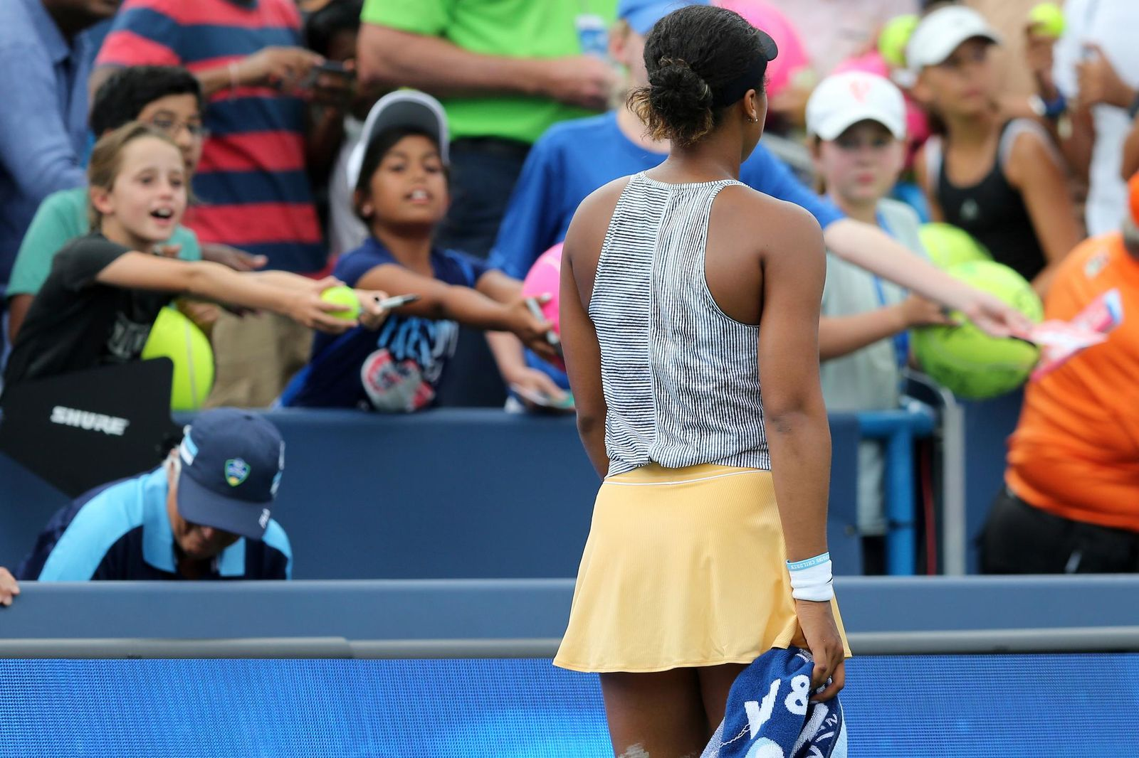 Naomi Osaka, of Japan, walks off the court after withdrawing from the match against Sofia Kenin, of the United States, in the quarterfinals of the Western & Southern Open tennis tournament Friday, Aug. 16, 2019, in Mason, Ohio. Osaka withdrew from the match. (Kareem Elgazzar/The Cincinnati Enquirer via AP)