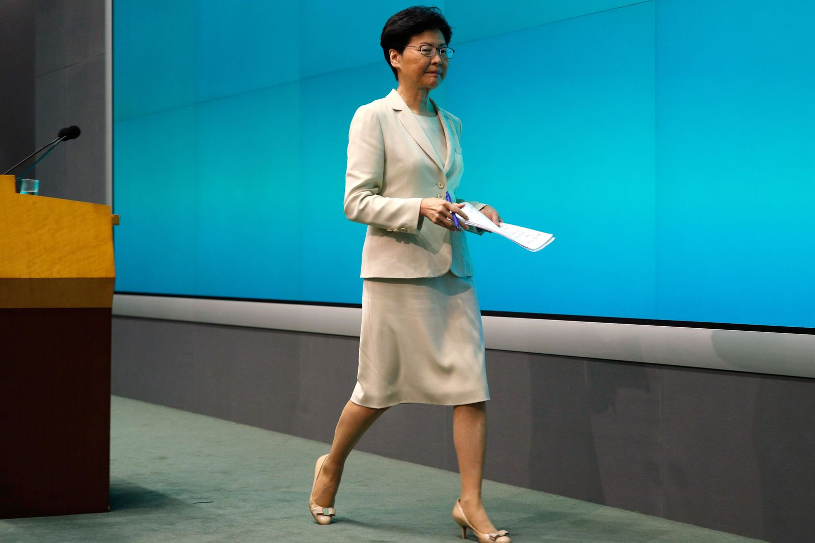 Hong Kong Chief Executive Carrie Lam leaves after a press conference at the Legislative Council in Hong Kong, Tuesday, June 18, 2019. Lam apologized Tuesday for an unpopular extradition bill that drew massive protests and indicated that it will not be revived during the current legislative session. (AP Photo/Vincent Yu)