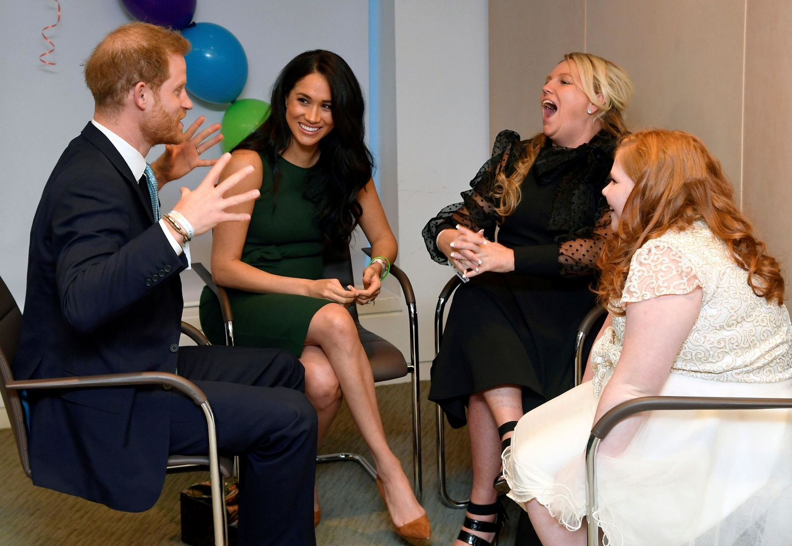 Britain's Prince Harry and Duchess of Sussex, left, meet with Milly Sutherland, right, and her mother Angela during the annual WellChild Awards in London, Tuesday Oct. 15, 2019. (Toby Melville/Pool via AP)