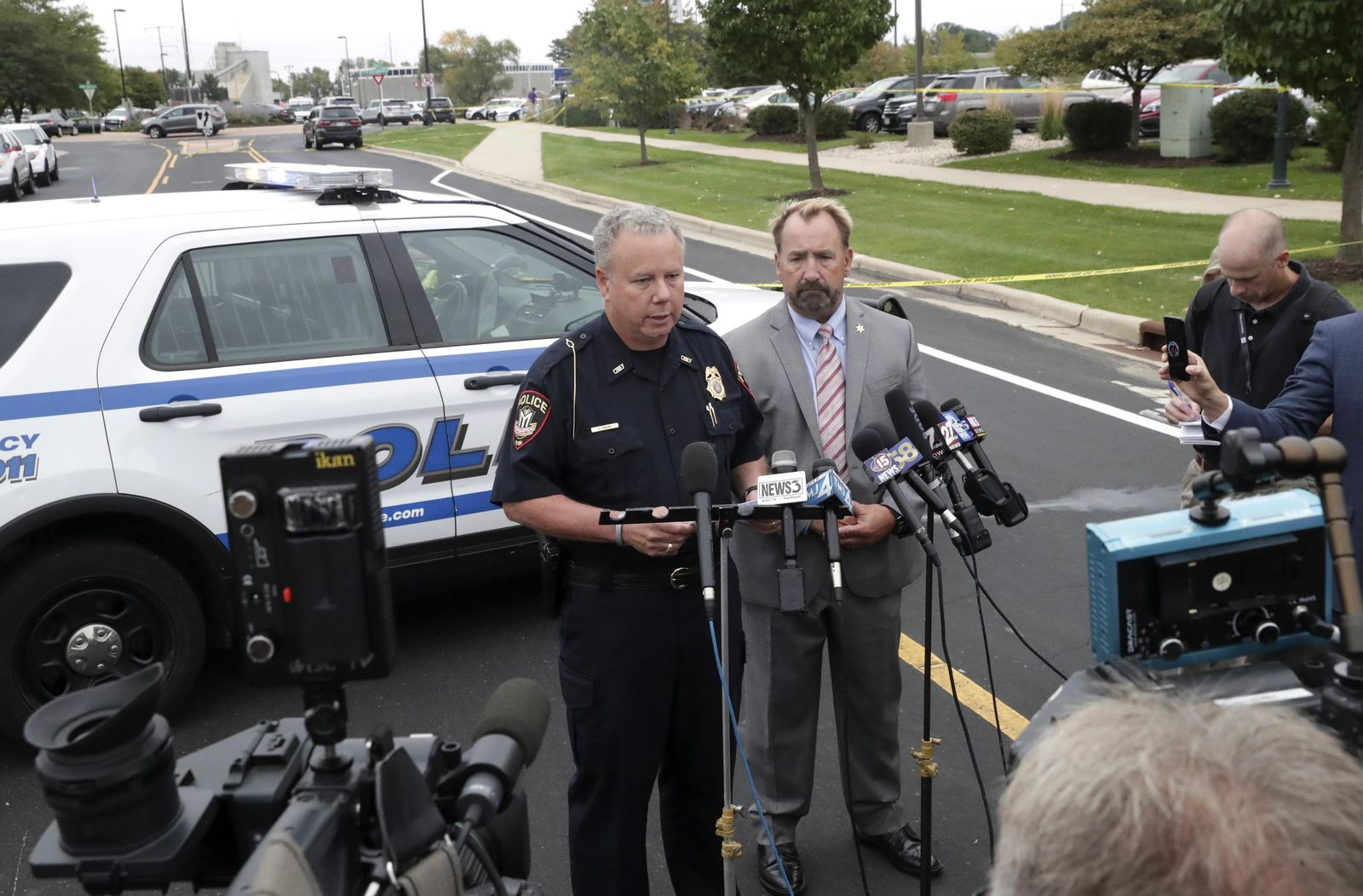 Middleton Police Chief Charles Foulke, left, and Dane County Sheriff Dave Mahoney hold a news conference near the scene of a shooting Wednesday Sept. 19, 2018, in Madison. (Steve Apps/Wisconsin State Journal via AP)