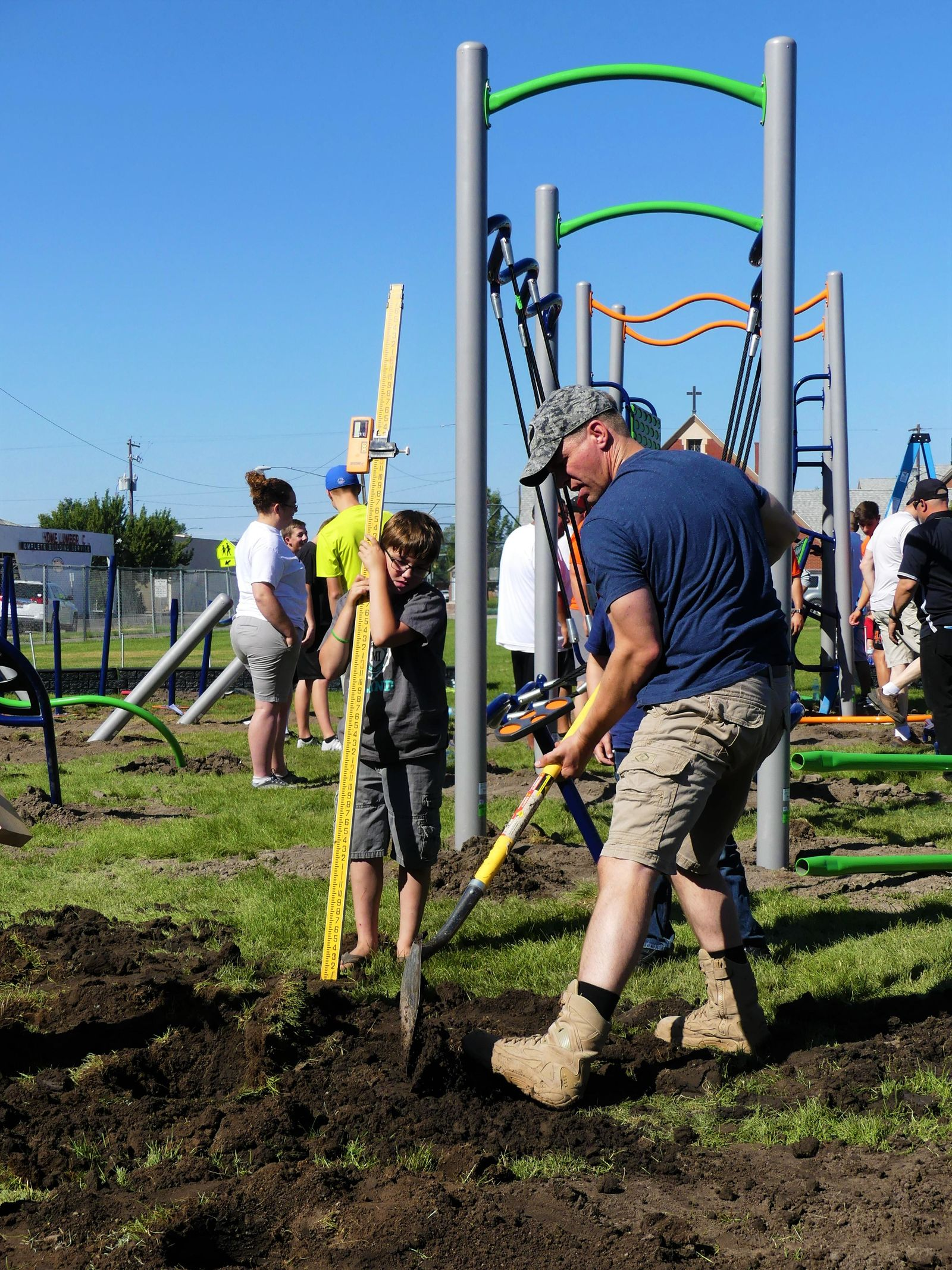Over 90 people came out to Hacker Middle School in Mountain Home, Saturday morning, to help build the school's first playground. Volunteers also repainted lineson the school's basketball courts, created a yoga space, and gave theplayground a new hacker Middle School logo.{ }(Michael Freeman)