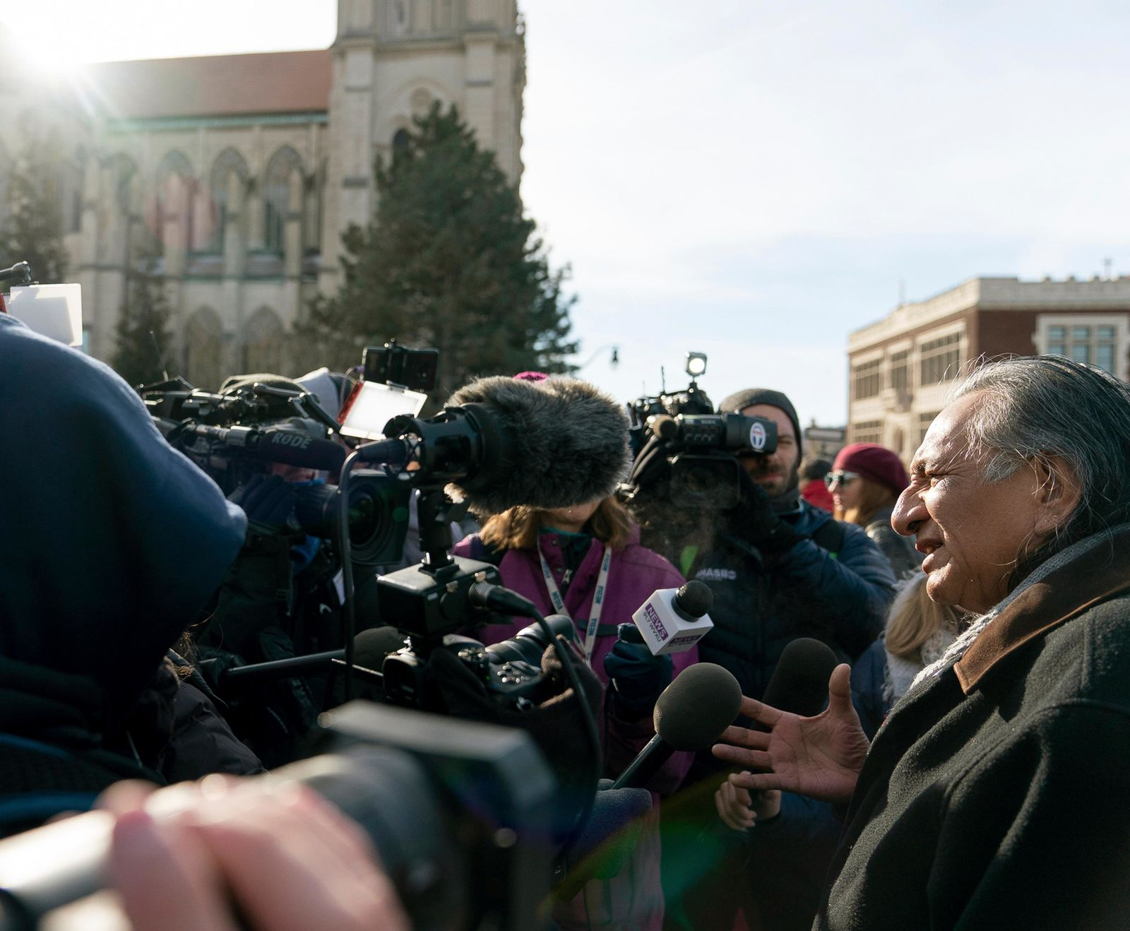 Guy Jones speaks to the press during a gathering in front of the Catholic Diocese in Covington, Ky., Tuesday, Jan. 22, 2019. Jones organized Tuesday's gathering of Native American supporters. (AP Photo/Bryan Woolston)