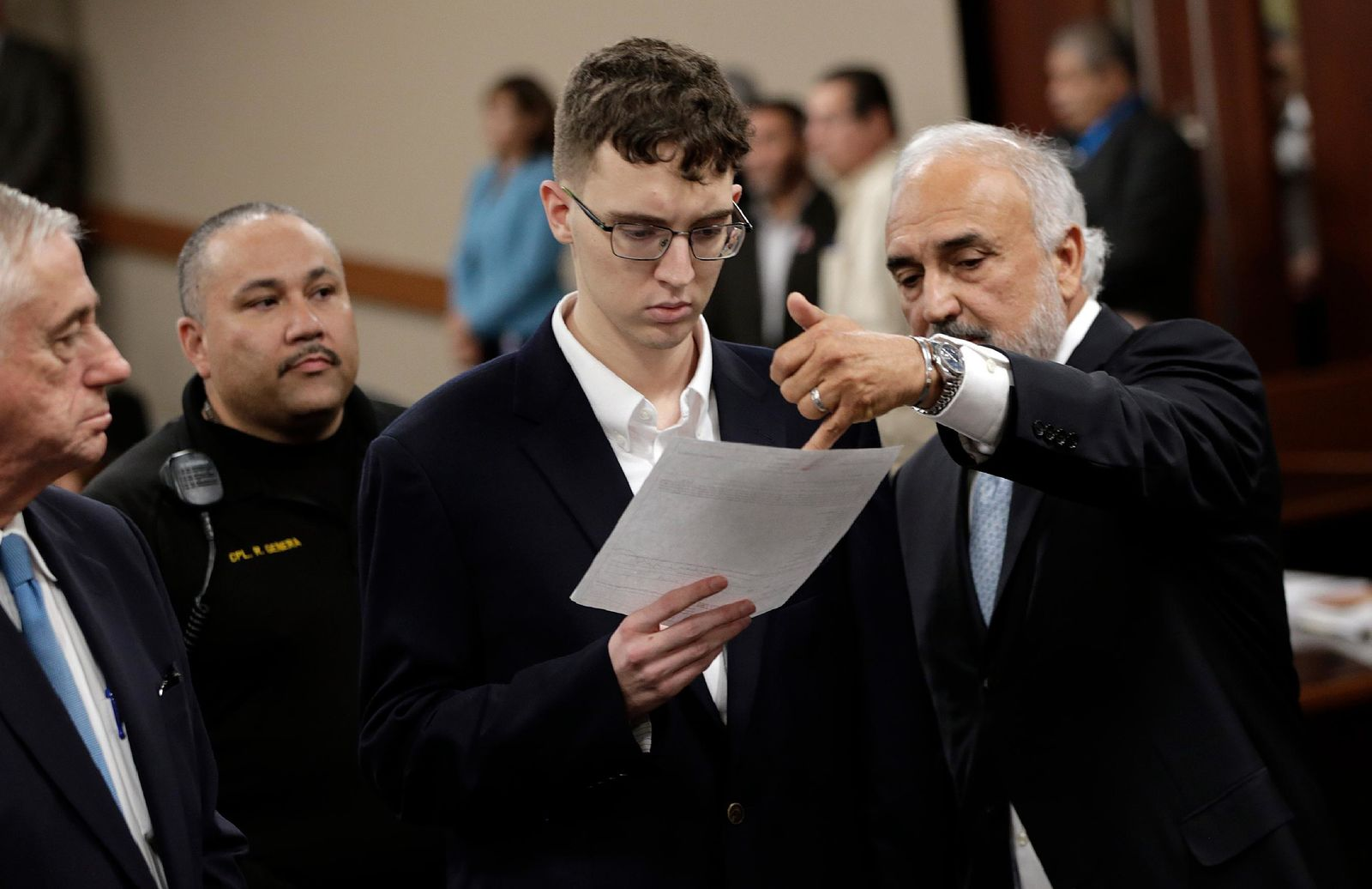 El Paso Walmart mass shooter Patrick Crusius is arraigned Thursday, Oct. 10, 2019, in the 409th state District Court with Judge Sam Medrano presiding. Crusius, 21,  from Allen, Texas, stands accused of killing 22 and injuring 25 in the Aug. 3, 2019, mass shooting at an East El Paso Walmart in the seventh deadliest mass shooting in modern U.S. history and third deadliest in Texas. Crusius entered a not guilty plea alongside his attorneys Mark Stevens and Joe Spencer. (Mark Lambie/The El Paso Times via AP, Pool)