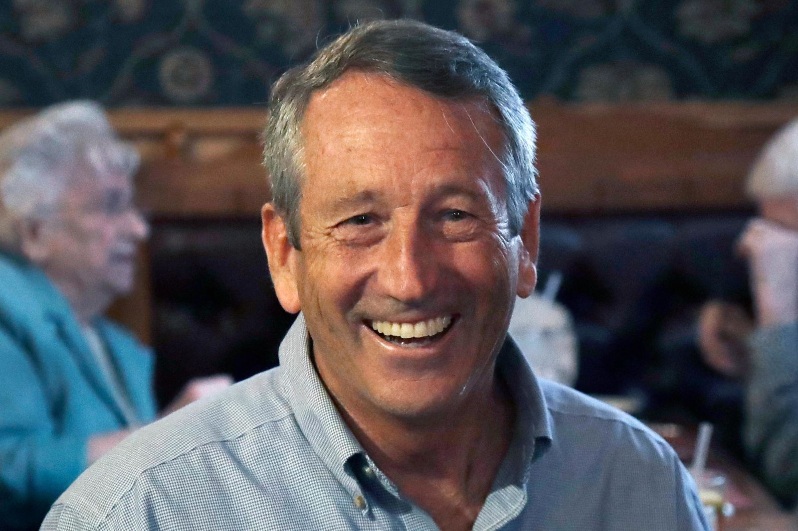 Republican presidential candidate, former South Carolina Gov. Mark Sanford smiles as he talks with customers at the Puritan Backroom restaurant, during a campaign stop, Thursday, Sept. 19, 2019, in Manchester, N.H. (AP Photo/Elise Amendola)