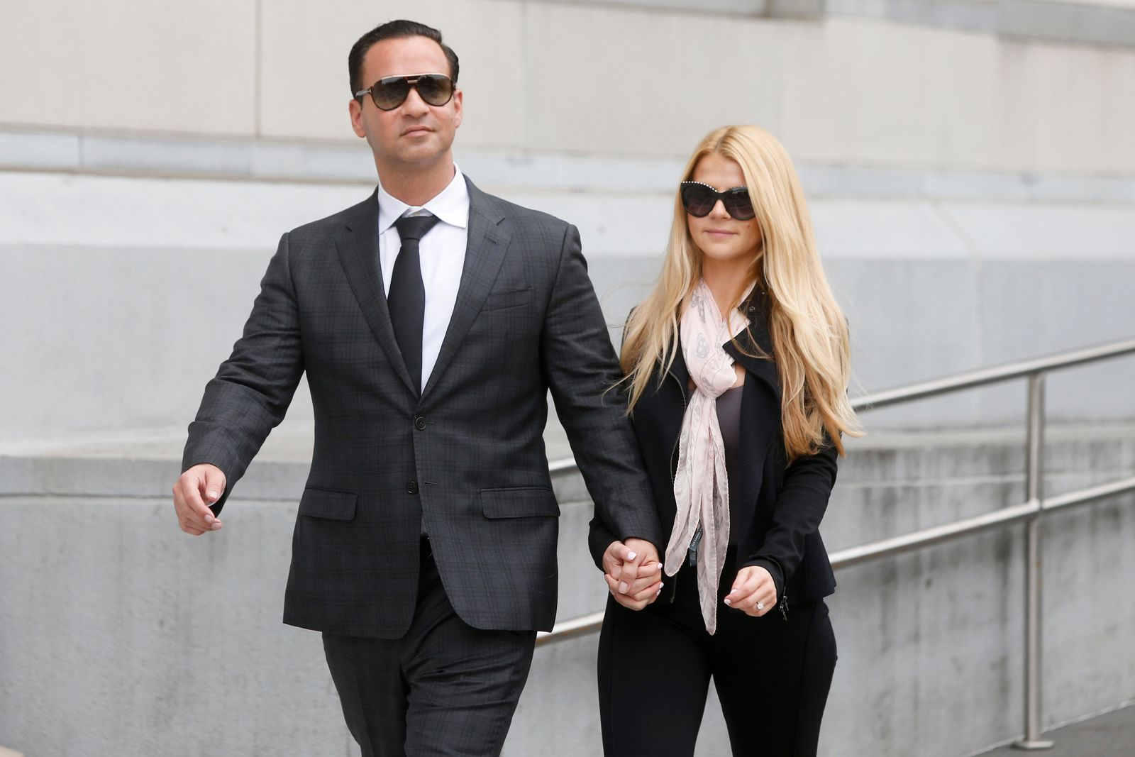 "FILE - In this Oct. 5, 2018, file photo, Michael ""The Situation"" Sorrentino leaves federal court with his fiancee Lauren Pesce after his sentencing in Newark, N.J. (Aristide Economopoulos/NJ Advance Media via AP, File)"