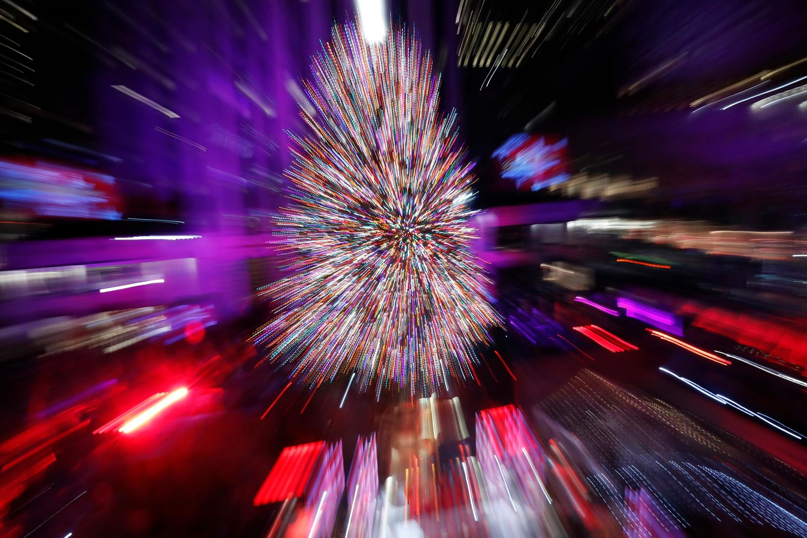 The Rockefeller Center Christmas Tree is shown in a time exposure in which the photographer's lens was zoomed simultaneously during the exposure at the 87th annual Rockefeller Center Christmas Tree lighting ceremony, Wednesday, Dec. 4, 2019, in New York. (AP Photo/Kathy Willens)
