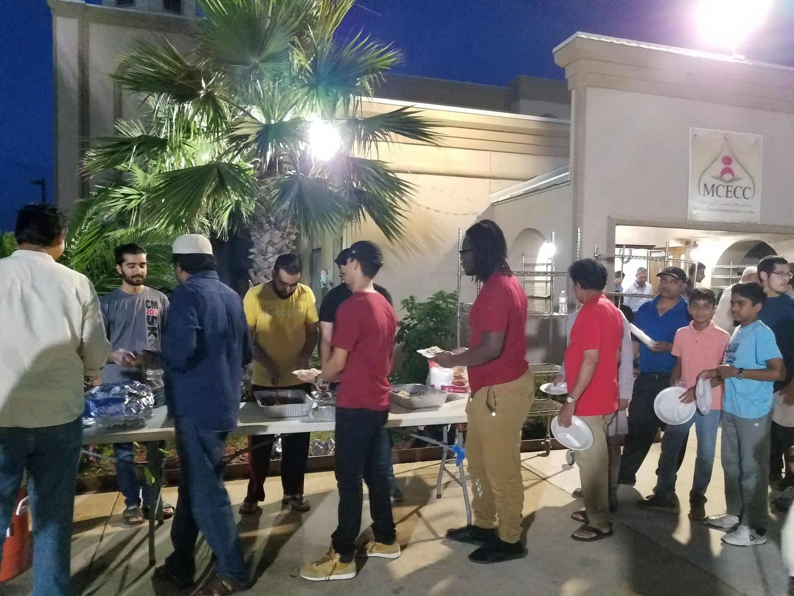 The local Muslim community celebrates with non-Muslims at the recent Fastathon at the Muslim Children Education and Civic Center. (SBG San Antonio)
