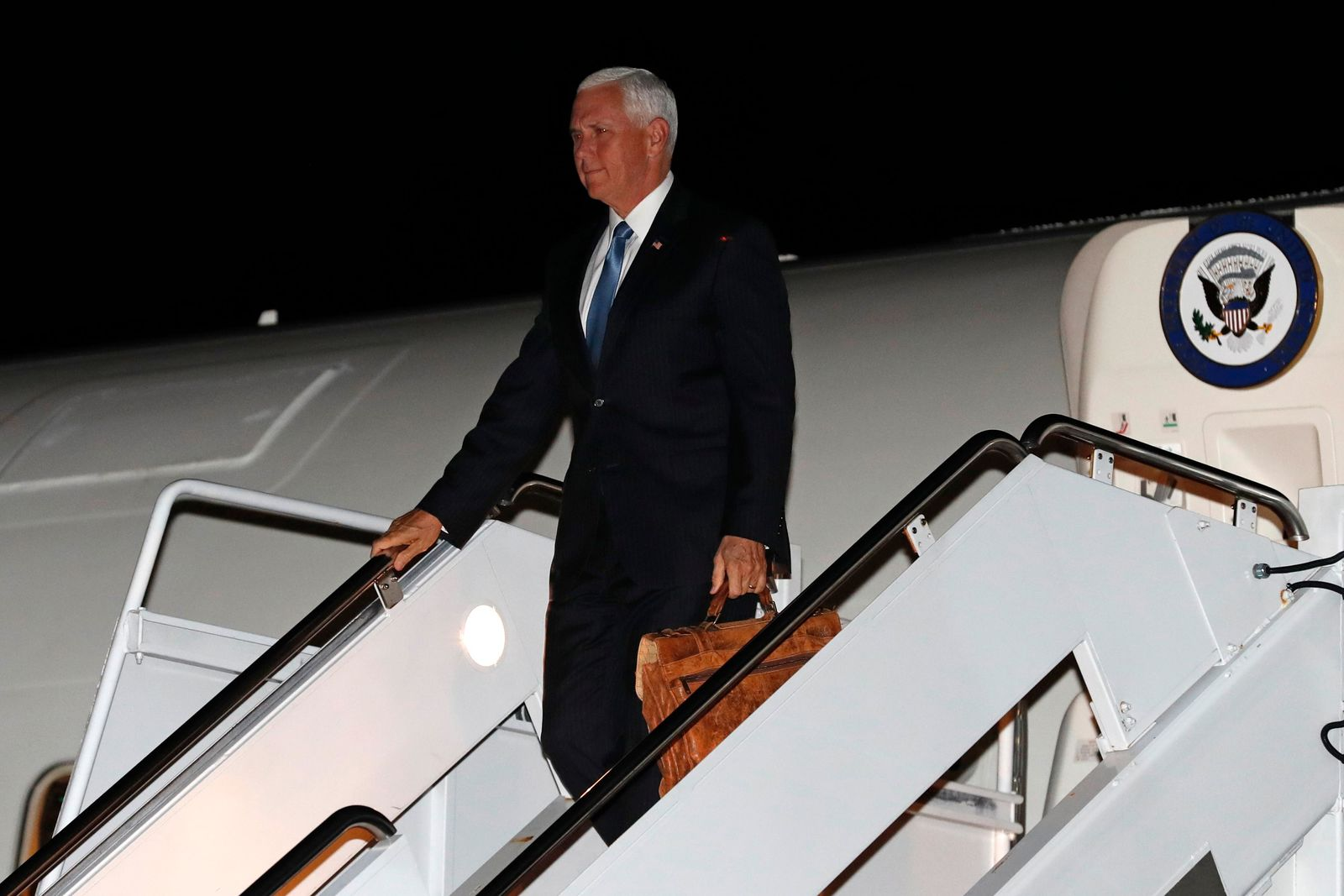 Vice President Mike Pence walks down the steps of Air Force Two, at Andrews Air Force Base, Md., Friday, Oct. 18, 2019, after his visit to Turkey to attend talks about the Kurds and Syria. (AP Photo/Jacquelyn Martin)