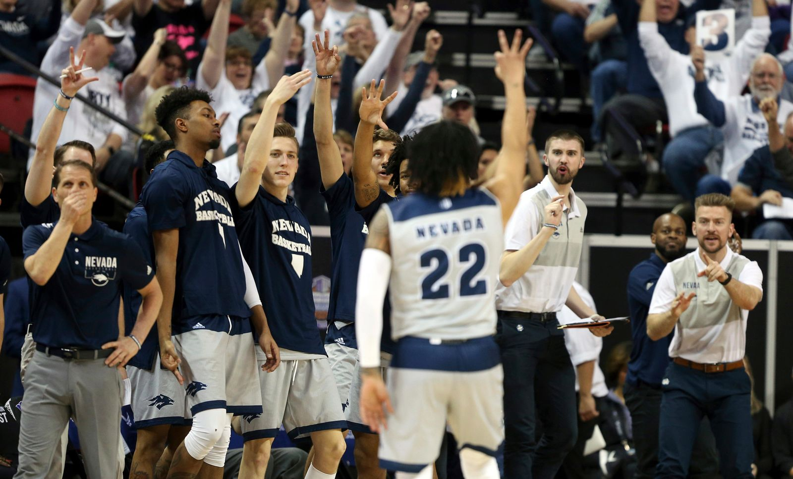 The Nevada bench reacts after Nevada's Jazz Johnson (22) sunk a 3-point shot during the second half of an NCAA college basketball game against Boise State in the Mountain West Conference men's tournament Thursday, March 14, 2019, in Las Vegas. (AP Photo/Isaac Brekken)