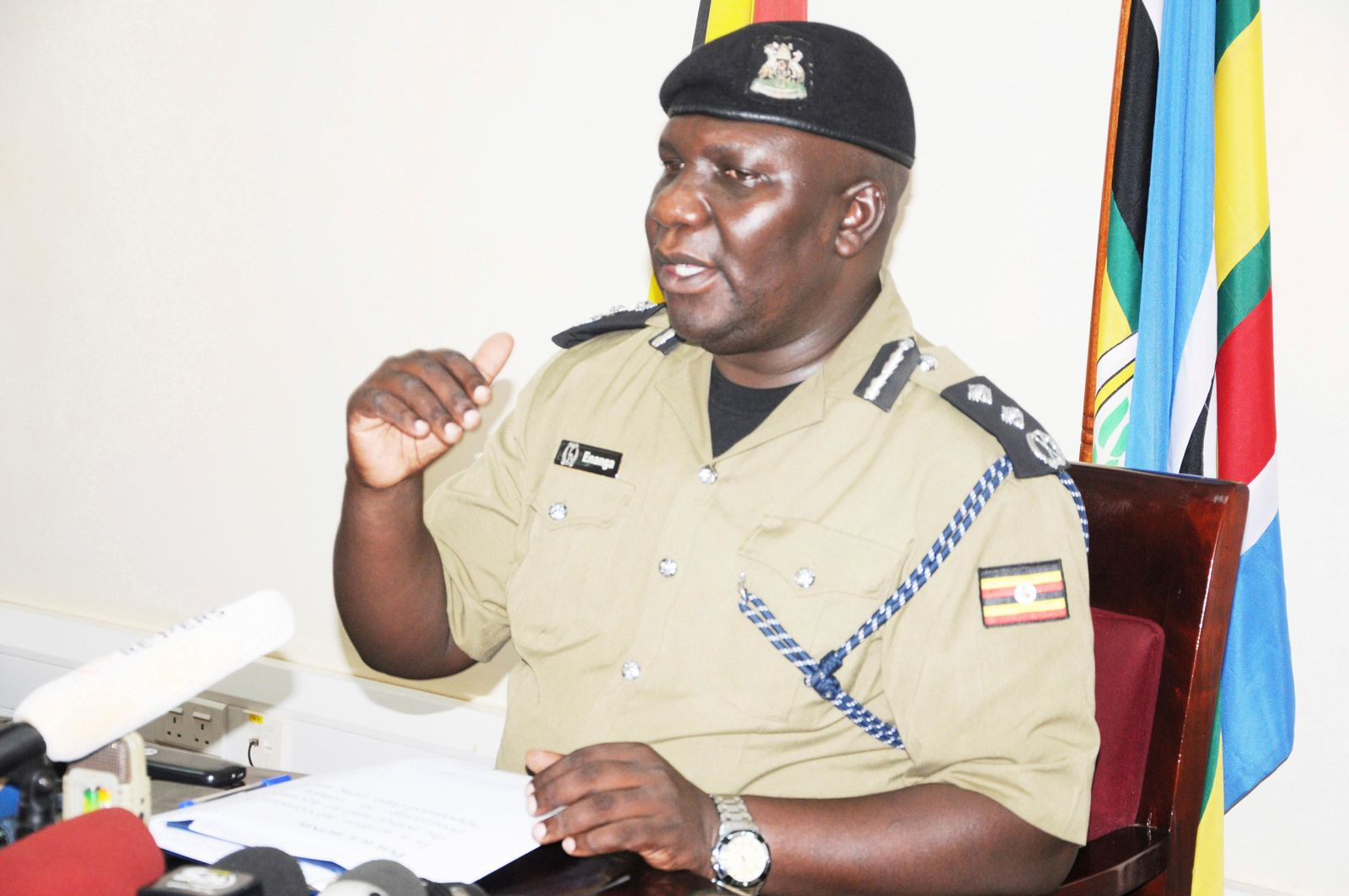 Police Spokesman Fred Enanga addressing a news Conference at the Police headquarters Monday, April 8. (AP Photo/Ronald Kabuubi)