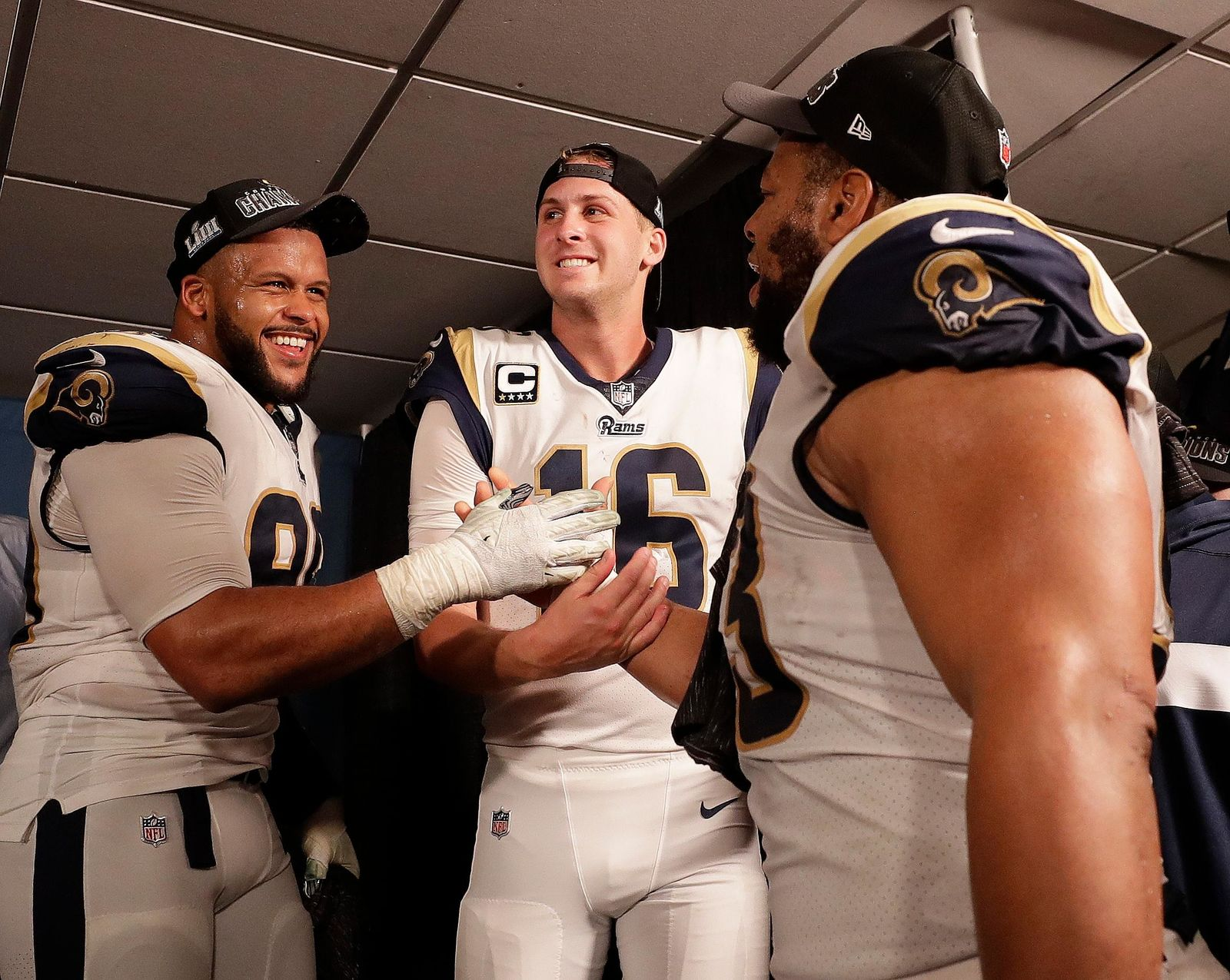 FILE - Los Angeles Rams defensive end Aaron Donald (99) Los Angeles Rams nose tackle Ndamukong Suh (93) and Los Angeles Rams quarterback Jared Goff (16) after overtime of the NFL football NFC championship game against the New Orleans Saints, Sunday, Jan. 20, 2019, in New Orleans. The Rams won 26-23.(AP Photo/David J. Phillip)