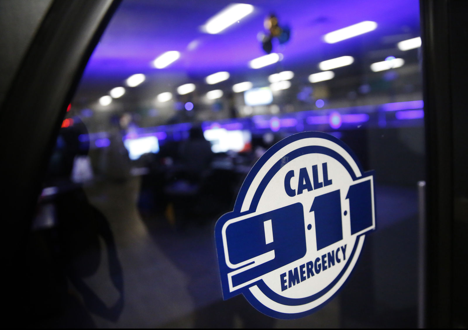 FILE - This May 3, 2019, file photo shows a police 911 call center. (Rose Baca/The Dallas Morning News via AP, File)